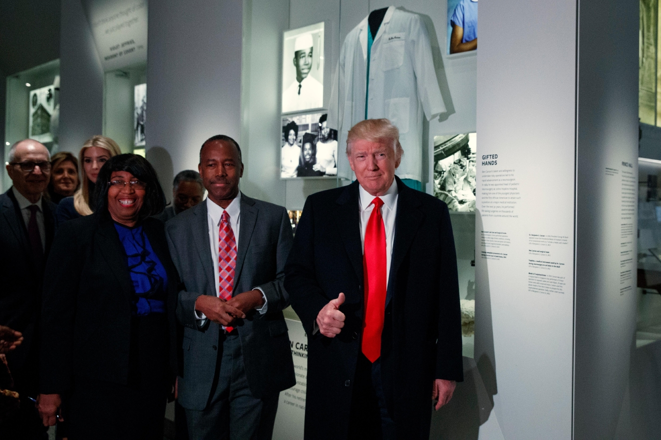 President Donald Trump gives a thumbs up during a tour of the National Museum of African American History and Culture with Housing and Urban Development Secretary-designate Dr. Ben Carson and his wife Candy Carson, Tuesday, Feb. 21, 2017, in Washington. (AP Photo/Evan Vucci)