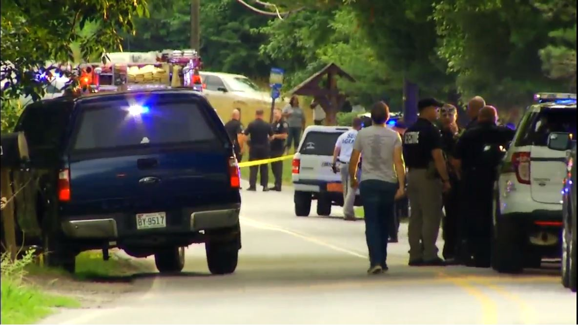 Asheville police identify victim, officer in Saturday Deaverview shooting (Photo credit WLOS staff)