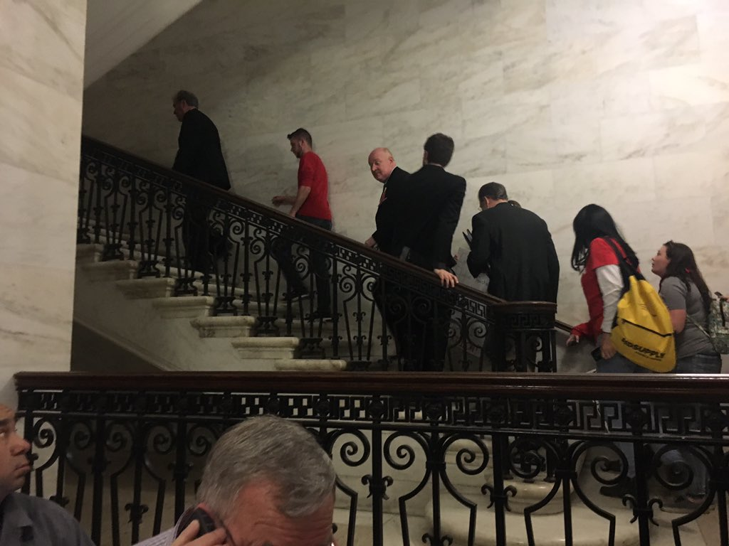 Union representatives head up the stairs Tuesday after emerging from negotiations with West Virginia Gov. Jim Justice. (WCHS/WVAH){&amp;nbsp;}<p></p>