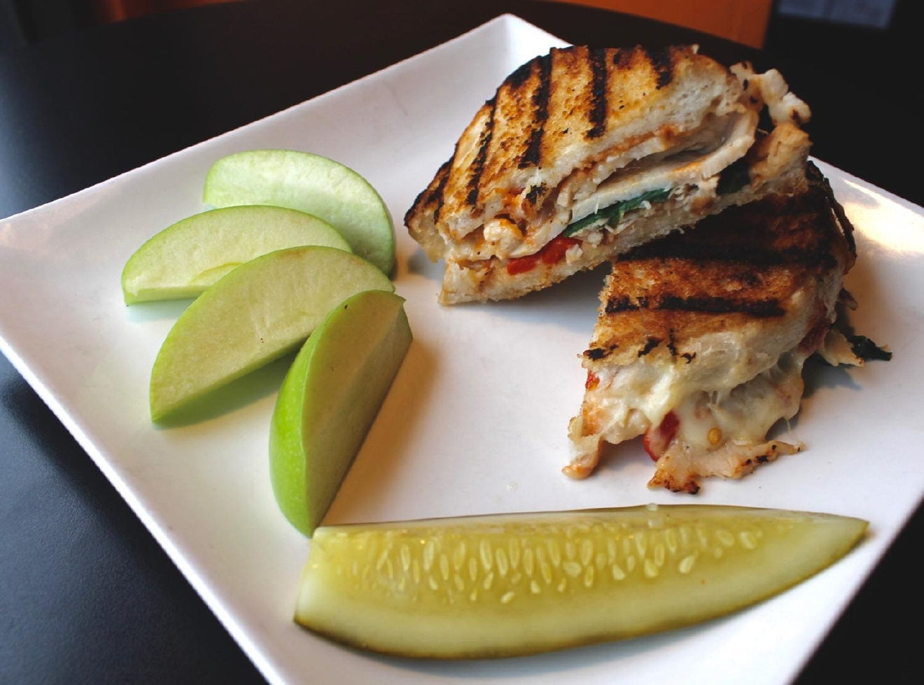 Turkey Panini : batard, bacon, roasted red peppers, spinach, smoked provolone, and sun-dried cherry chipotle aioli / Image: Rose Brewington // Published: 3.12.17