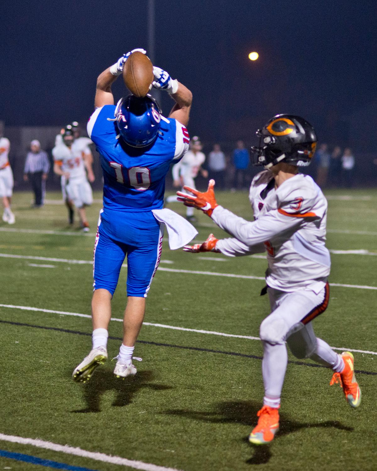 Churchill Lancers defensive back Tyson Bennion (#10) intercepts a pass intended for Crater Comets wide receiver Bailee Robles (#3). Churchill defeated Crater 63-21 on Friday at their homecoming game. Churchill remains undefeated with a conference record of 9-0. Photo by Dan Morrison, Oregon News Lab