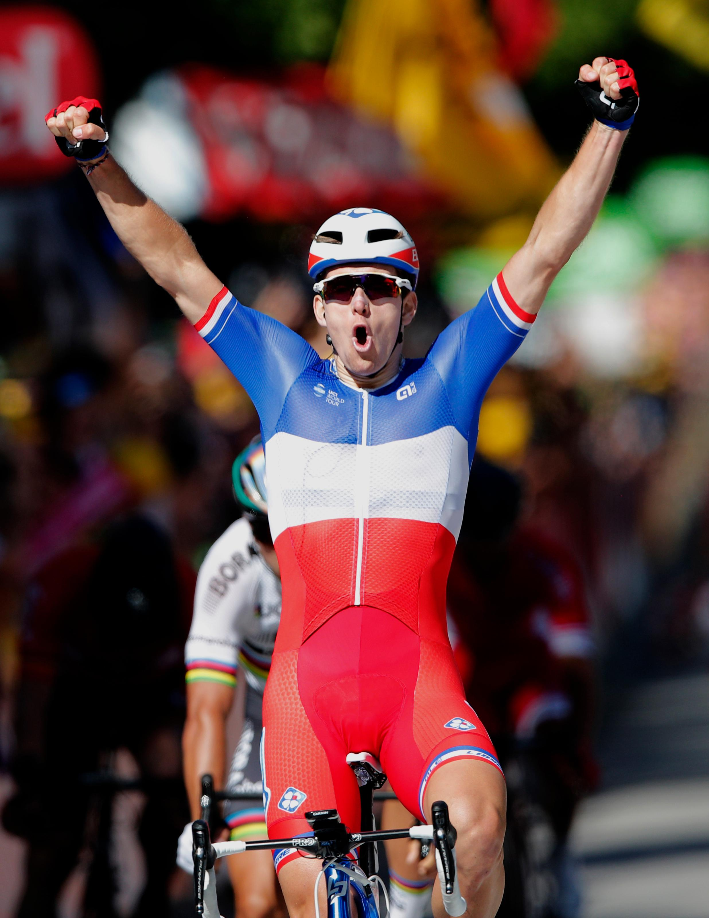 France's Arnaud Demare crosses the finish line to win the fourth stage of the Tour de France cycling race over 207.5 kilometers (129 miles) with start in Mondorf-les-Bains, Luxembourg, and finish in Vittel, France, , Tuesday, July 4, 2017. (AP Photo/Christophe Ena)