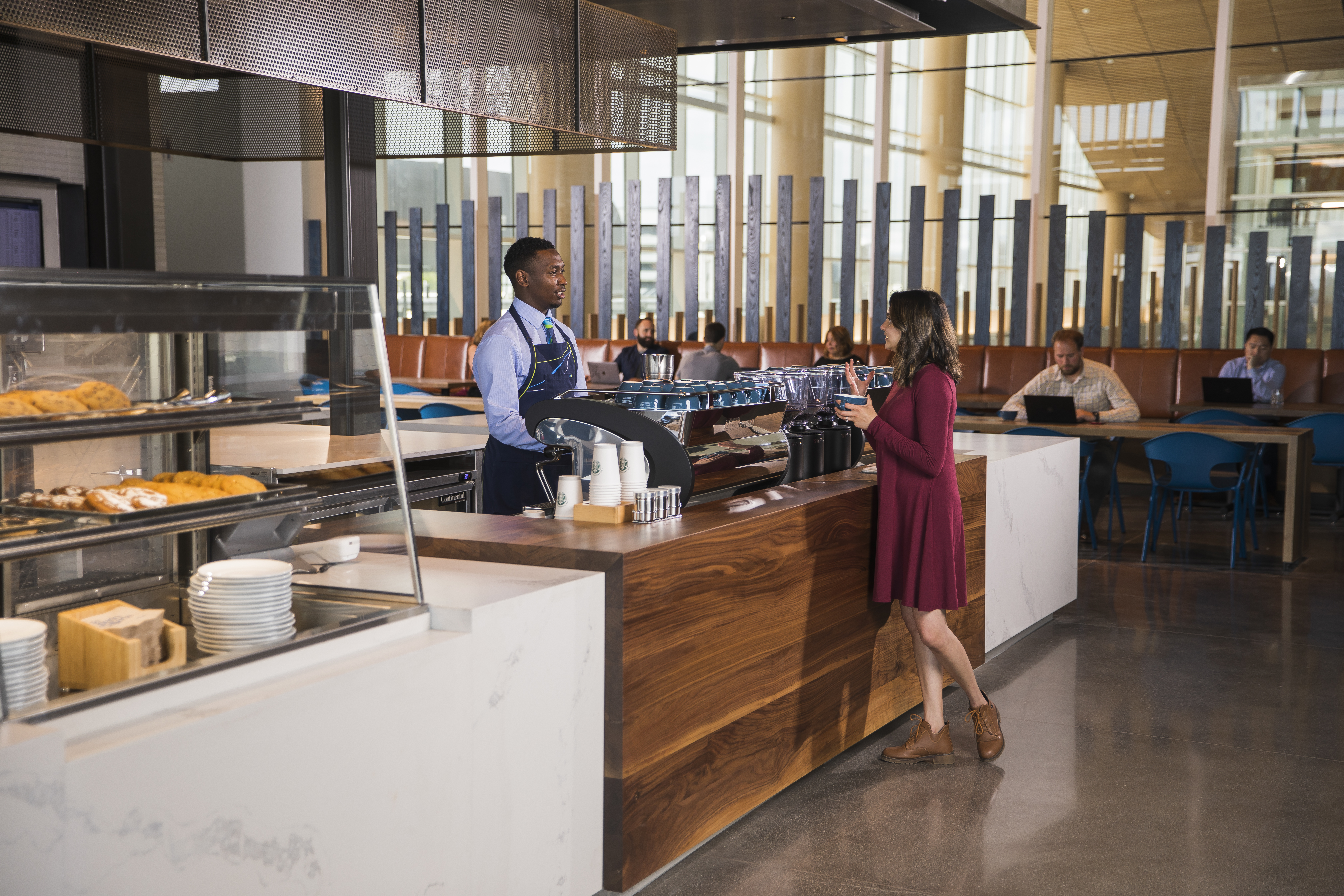 "A brand new Alaska Airlines lounge was just unveiled as part of Sea-Tac Airport and Port of Seattle's new North Satellite Modernization Project - and BOY is it a stunner. The $658.3 million project consists of eight new gates, expanded local dining, retail options, and this brand-spankin-new flagship Alaska Airlines Lounge. The 255,000 square-foot expansion replaces the old North Satellite, which worked for 45 years but had become ""a living time capsule"". Fliers will see Bambuza Vietnam Kitchen, Skillet, Caffe D'Arte, The New Stand, a brand new Nursing Suite. (Image: Ingrid Barrentine / Alaska Airlines){ }"