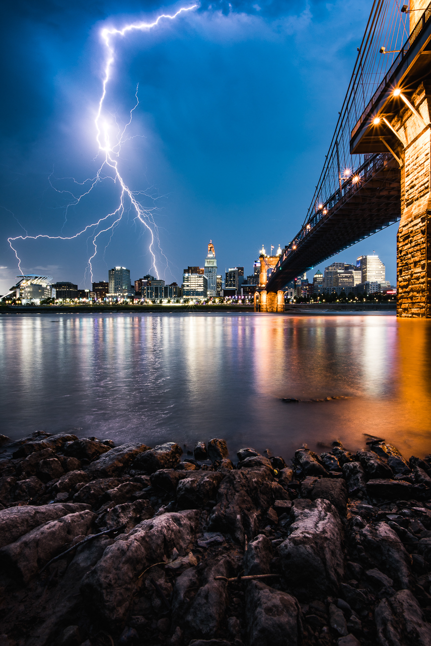 """My most memorable would have to be capturing the lightning bolt over the Cincinnati skyline. I remember I was driving around Newport when I saw lightning flashes behind the city and luckily I had my camera and tripod with me. I went to a spot I had picked out over in Covington by the Roebling Bridge and set up my camera to take continuous shots. When I saw that lightning bolt and heard my shutter close shut, I knew I got the shot. I'll never forget that feeling.""  / Image: Brendan Burkett // Published: 7.29.19"