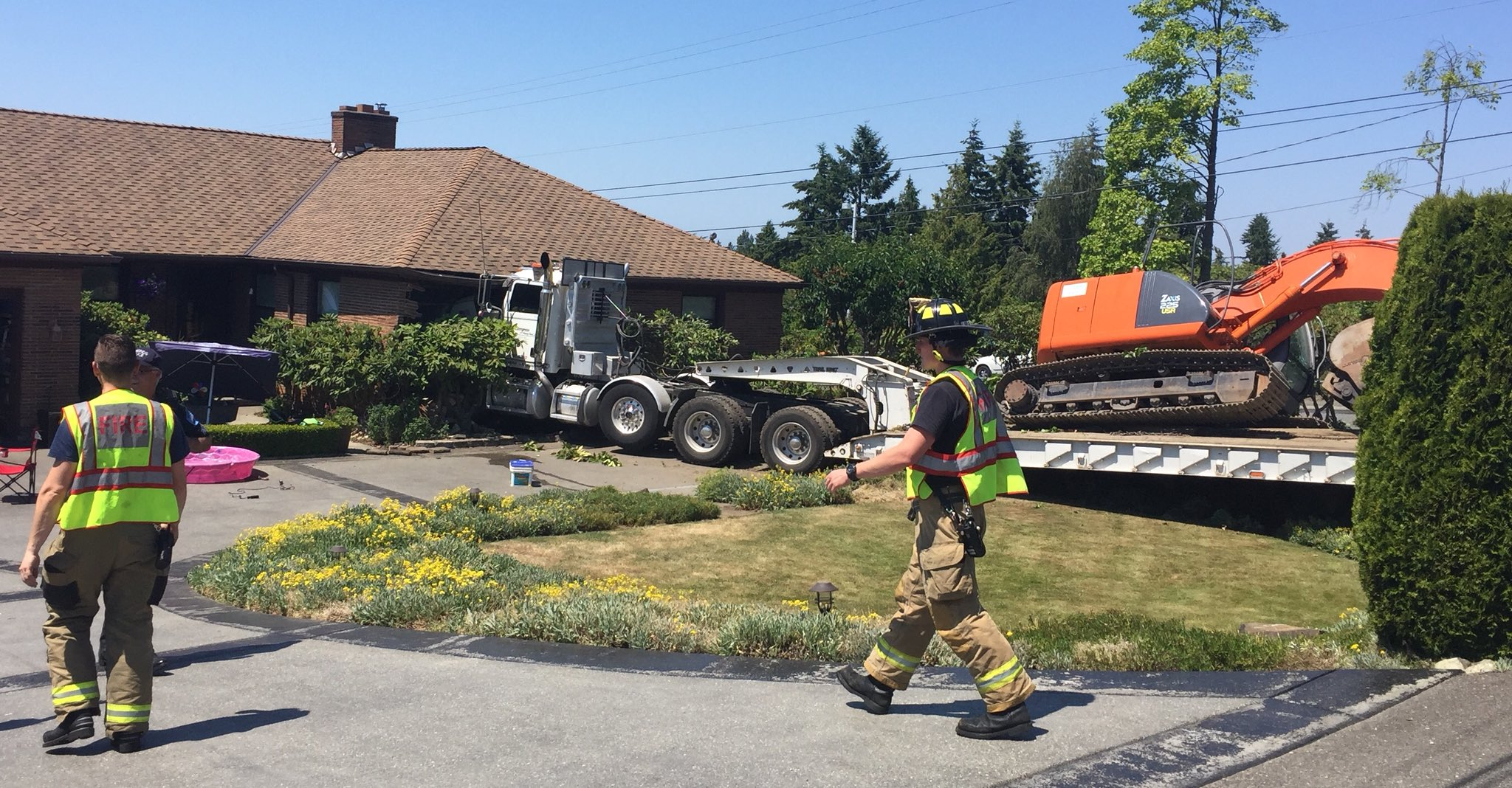 A semi truck without a driver crashed into a home in Edmonds Monday, June 18, 2018. (Photo: South Snohomish County Fire)