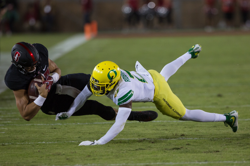 Oregon safety Tyree Robinson (#2) tackles the Stanford ball carrier. The Oregon Ducks are trailing the Stanford Cardinal 28-7 at halftime at Stanford Stadium in California.  Photo by Austin Hicks, Oregon News Lab