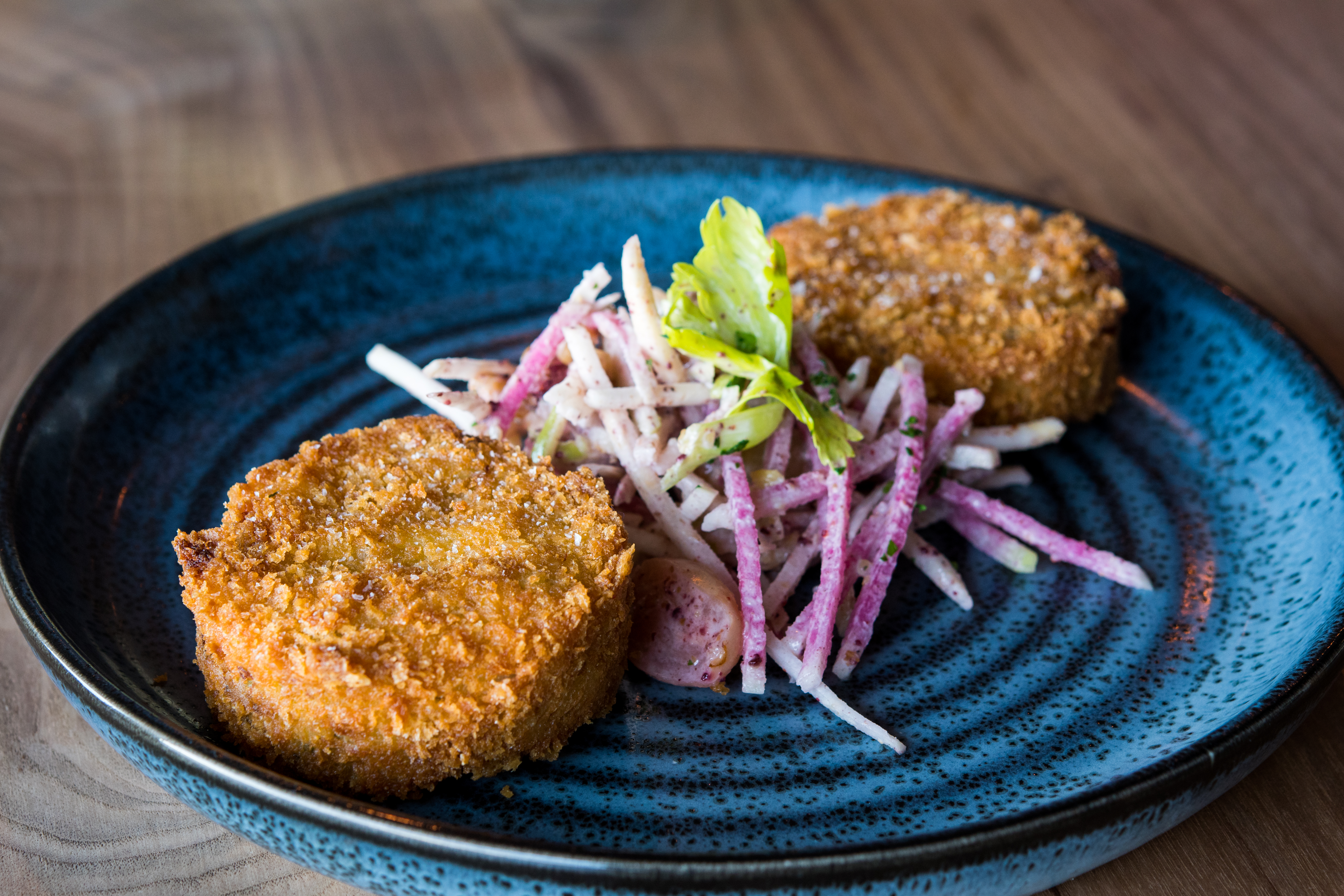 Crab Cakes with truffled celery, green apples and pickled grapes (Image courtesy of Fire Vine/Aerlume).