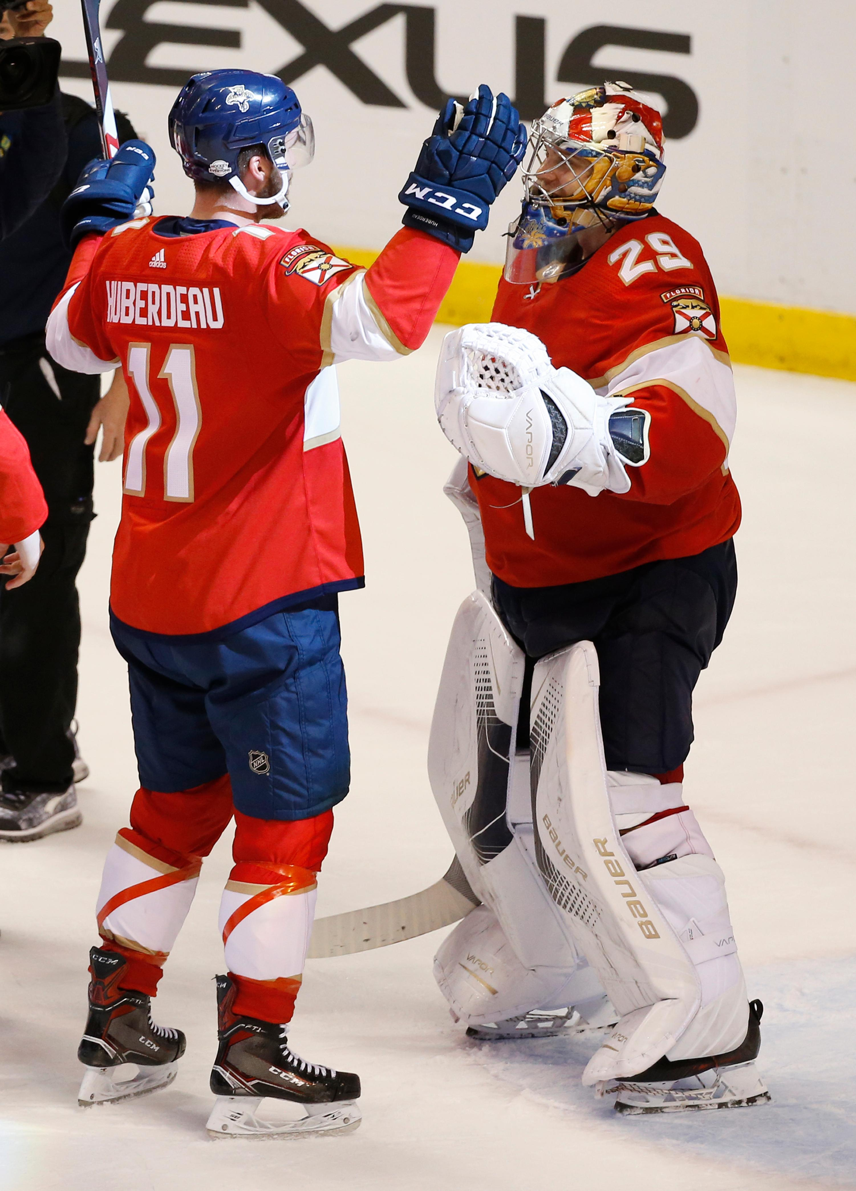 Florida Panthers left wing Jonathan Huberdeau (11) celebrates with goaltender Harri Sateri (29) after the Panthers defeated the Detroit Red Wings 3-2, during an NHL hockey game, Saturday, Feb. 3, 2018 in Sunrise, Fla. Huberdeau scored the game winning goal. (AP Photo/Wilfredo Lee)