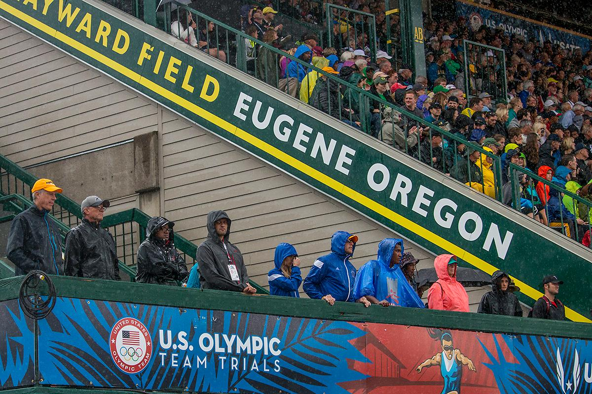 Coaches and spectators attempt to stay dry during the events. Day Eight of the U.S. Olympic Trials Track and Field continued on Friday at Hayward Field in Eugene, Ore. and will continue through July 10. Photo by Katie Pietzold