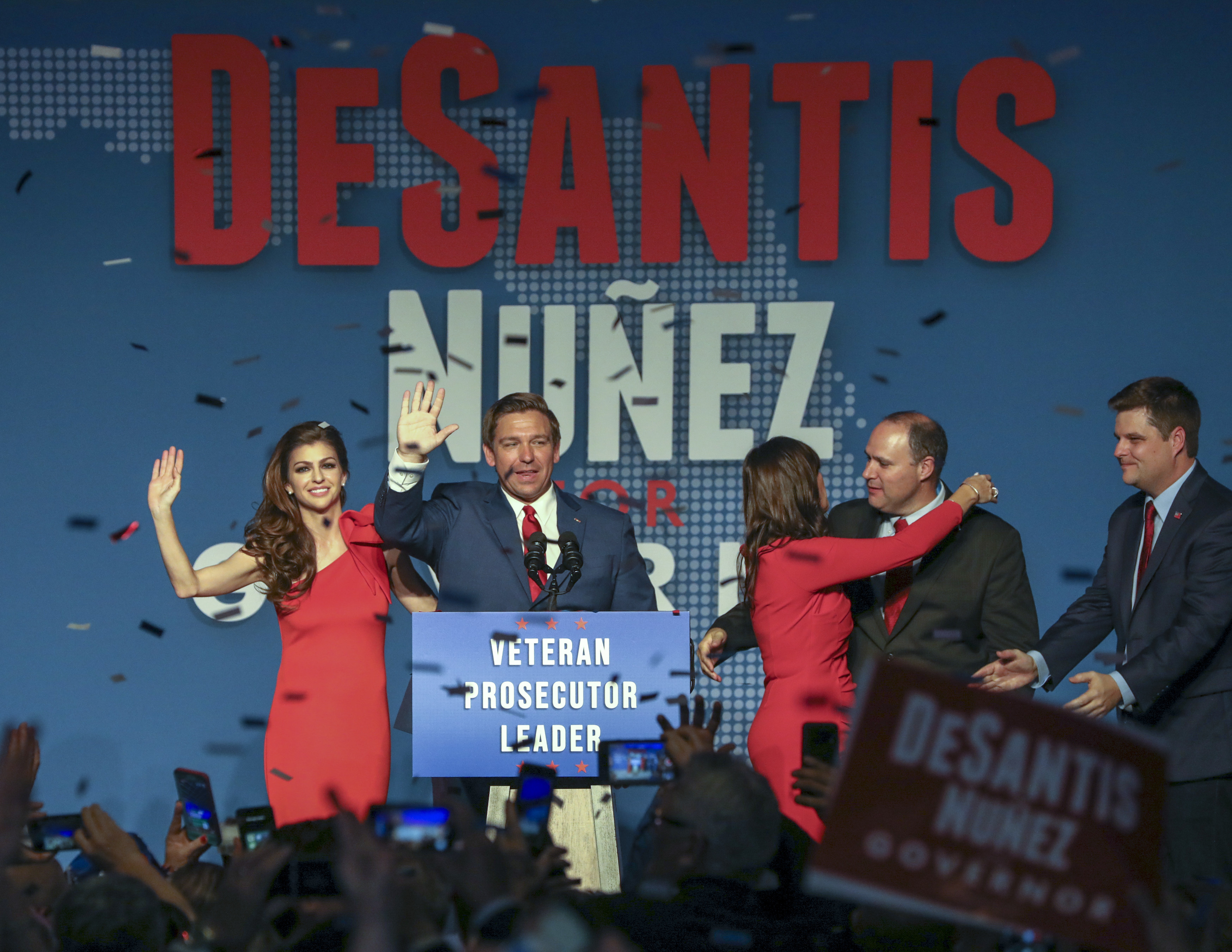 Republican Florida Governor-elect Ron DeSantis, center, waves to the supporters with his wife, Casey, left, and Republican Lt. Governor-elect Jeanette Nunez. (Chris Urso/Tampa Bay Times via AP)
