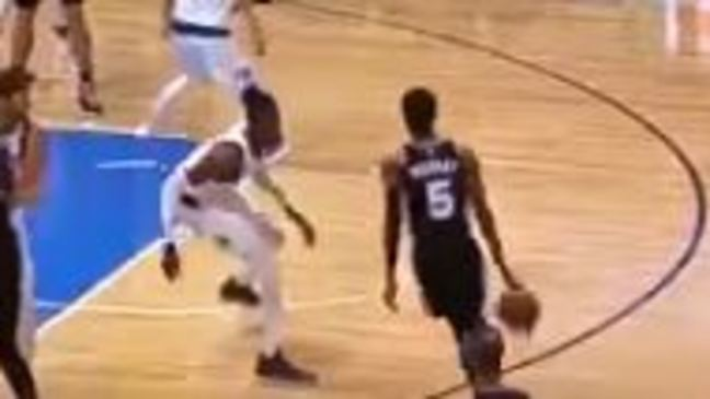 WATCH: Dejounte Murray sends Mavs' Noel to the floor with nasty crossover
