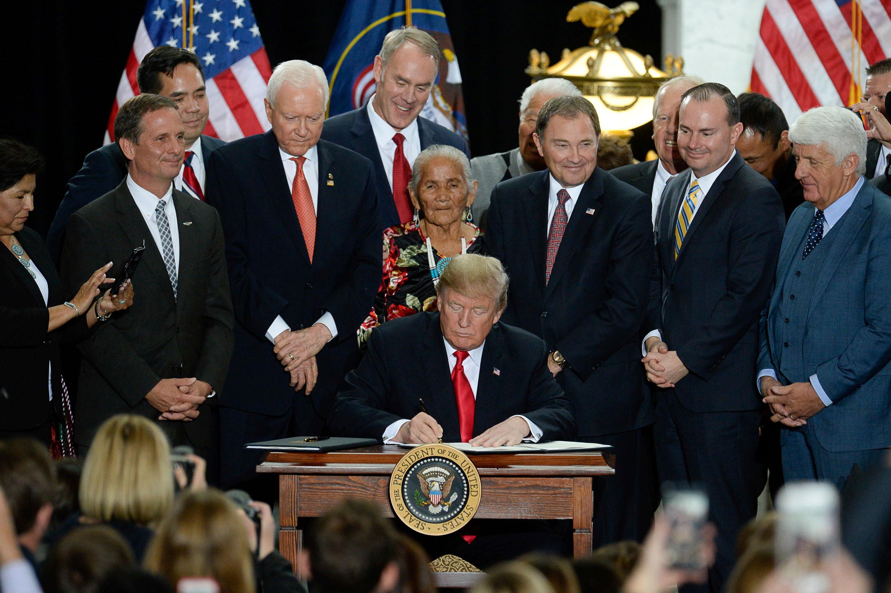 President Donald Trump is surrounded by Utah representatives at the Utah Capitol on Monday, Dec. 4, 2017, as he signs two presidential proclamations to shrink Bears Ears and Grand Staircase-Escalante national monuments.  (Francisco Kjolseth/The Salt Lake Tribune via AP)