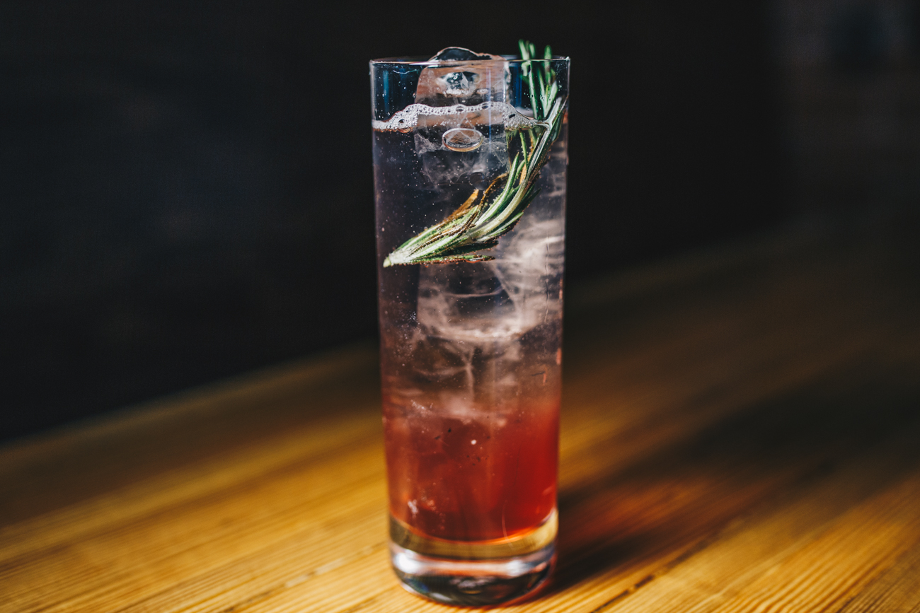 Rosemary's Berry: Wheatley vodka, dry vermouth, rosemary syrup, blueberry grenadine, lemon, and soda / Image: Catherine Viox // Published: 2.25.19