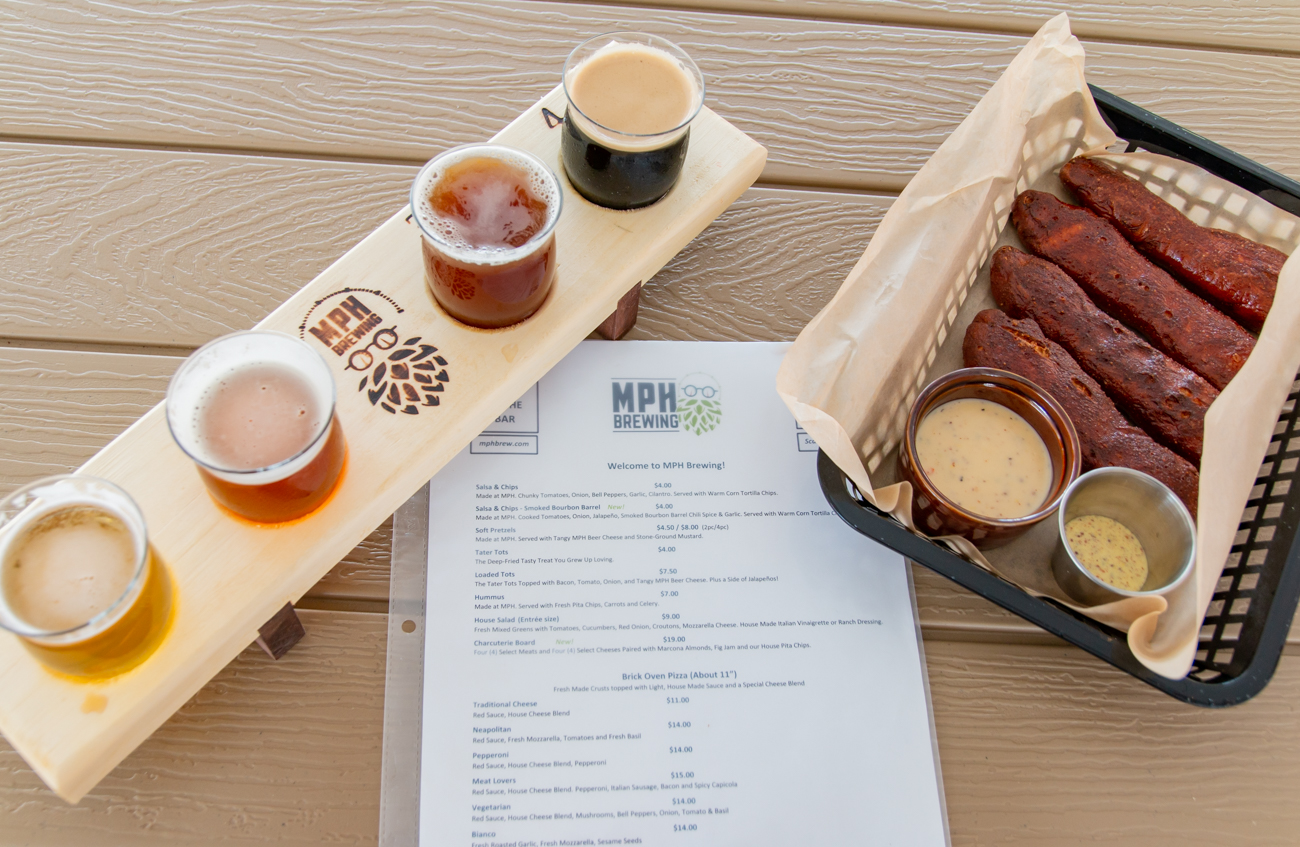 Soft-baked pretzels with tangy MPH beer cheese and stone ground mustard pairs well with a beer flight on the covered patio. / Image: Elizabeth A. Lowry // Published: 7.20.20
