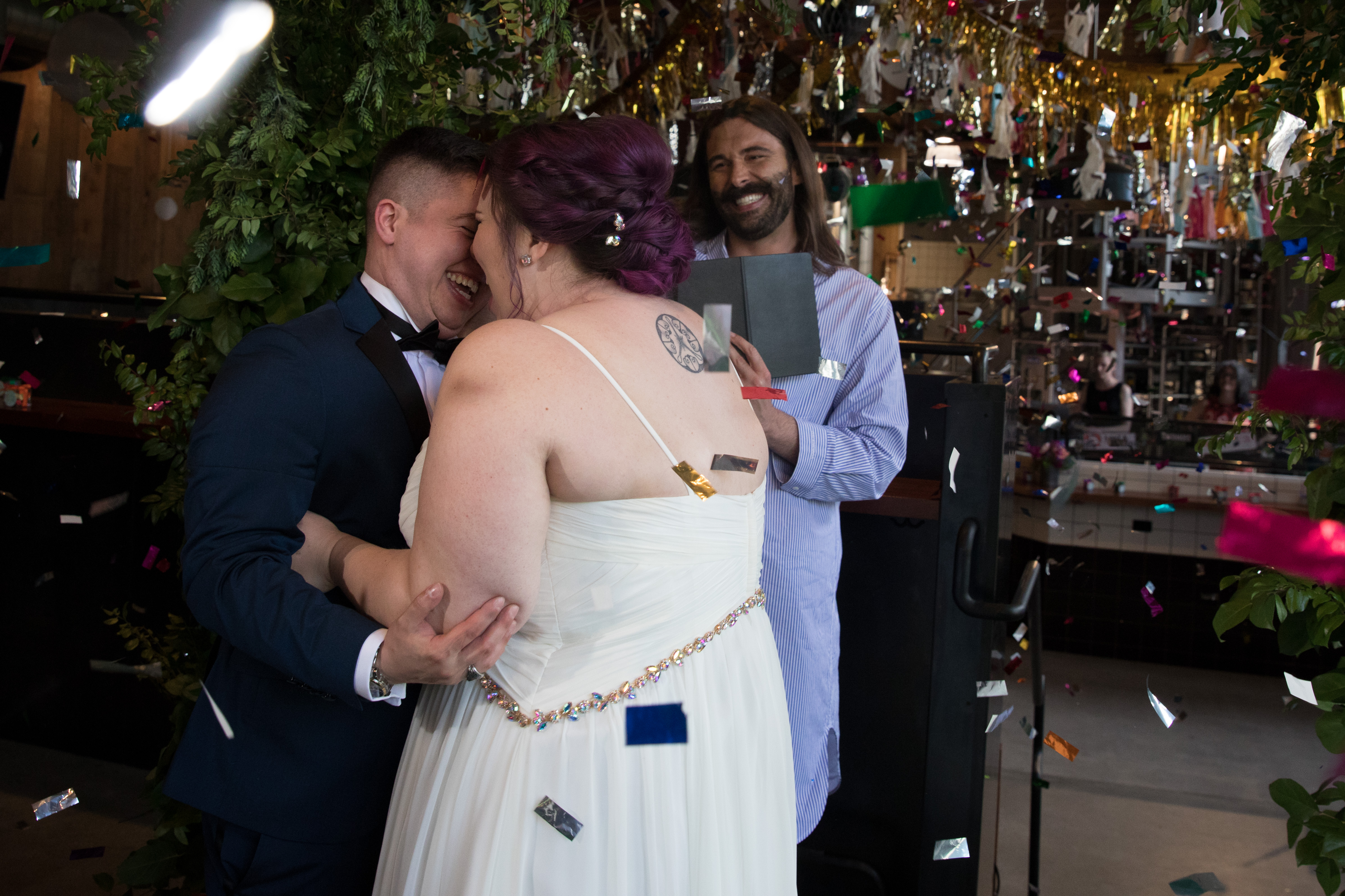CAN YOU EVEN BELIEVE?!{ } #MarryUsJVN contest winners, Megan (right) and Haden (left) share a first kiss at the altar after being wed by LGBTQ+ advocate, Jonathan Van Ness, at Elysian Brewing's Capitol Hill brewpub in Seattle on June 4, 2019.(Photo by Matt Mills McKnight/Invision for Elysian Brewing/AP Images)