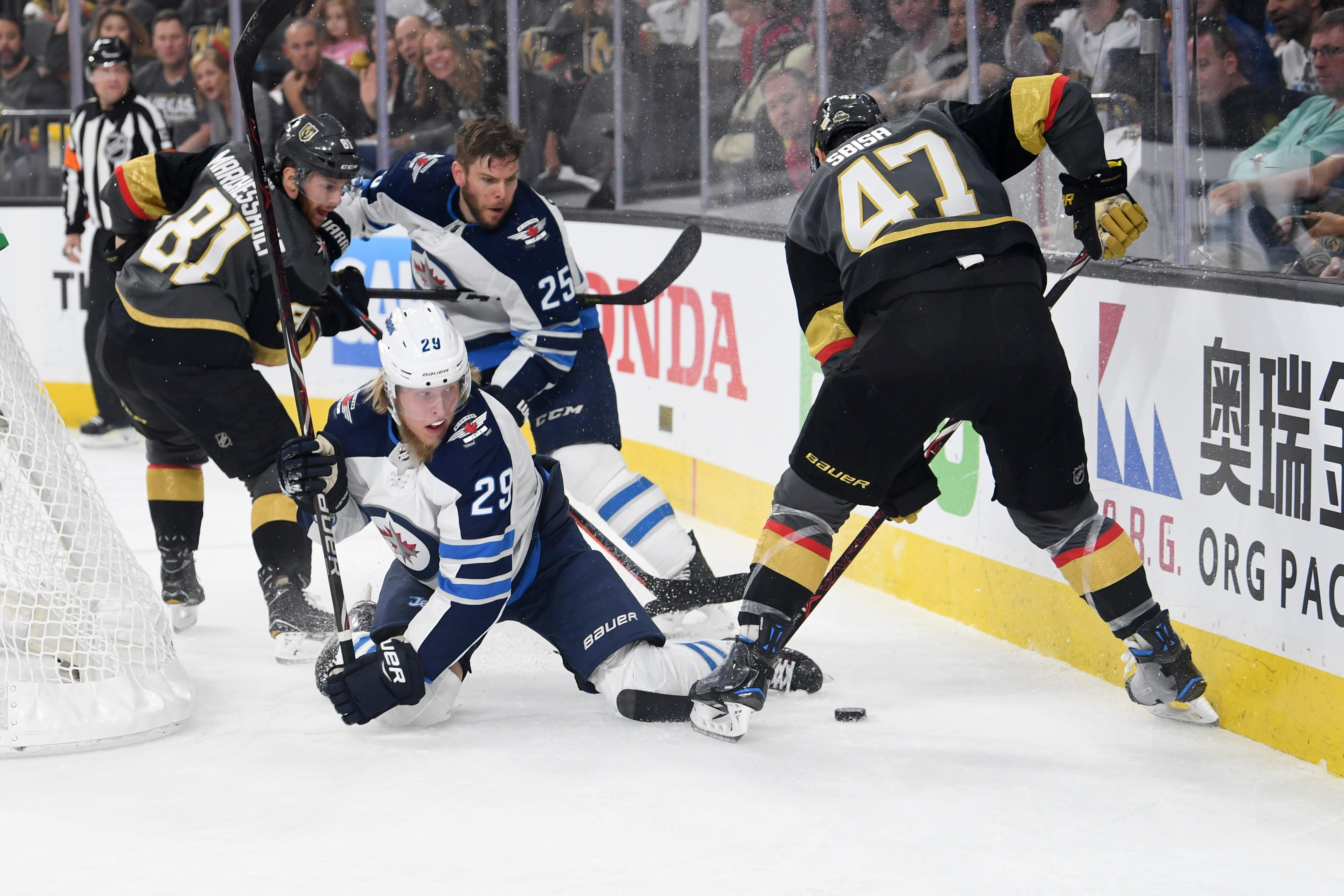 Winnipeg Jets right wing Patrik Laine (29) hits the ice as Vegas Golden Knights defenseman Luca Sbisa (47) tries to clear the puck from behind his net during Game 4 of their NHL hockey Western Conference Final game Friday, May 18, 2018, at T-Mobile Arena. CREDIT: Sam Morris/Las Vegas News Bureau