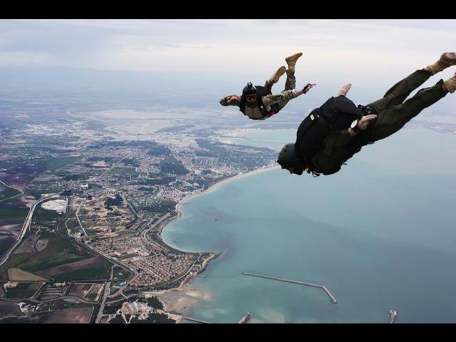 U.S. Navy Petty Officer 1st Class John Delong tracks with another parachutist during free fall training on Naval Station Rota Spain in Rota, Spain, April 14, 2014. Delong is assigned to Explosive Ordnance Disposal Mobile Unit 8.
