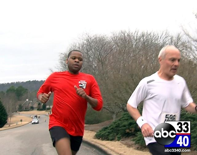 ABC 33/40 reporter Larry Miller running in the 10th Annual Brenda Ladun Conquer Cancer Run, Saturday, March 1, 2014.