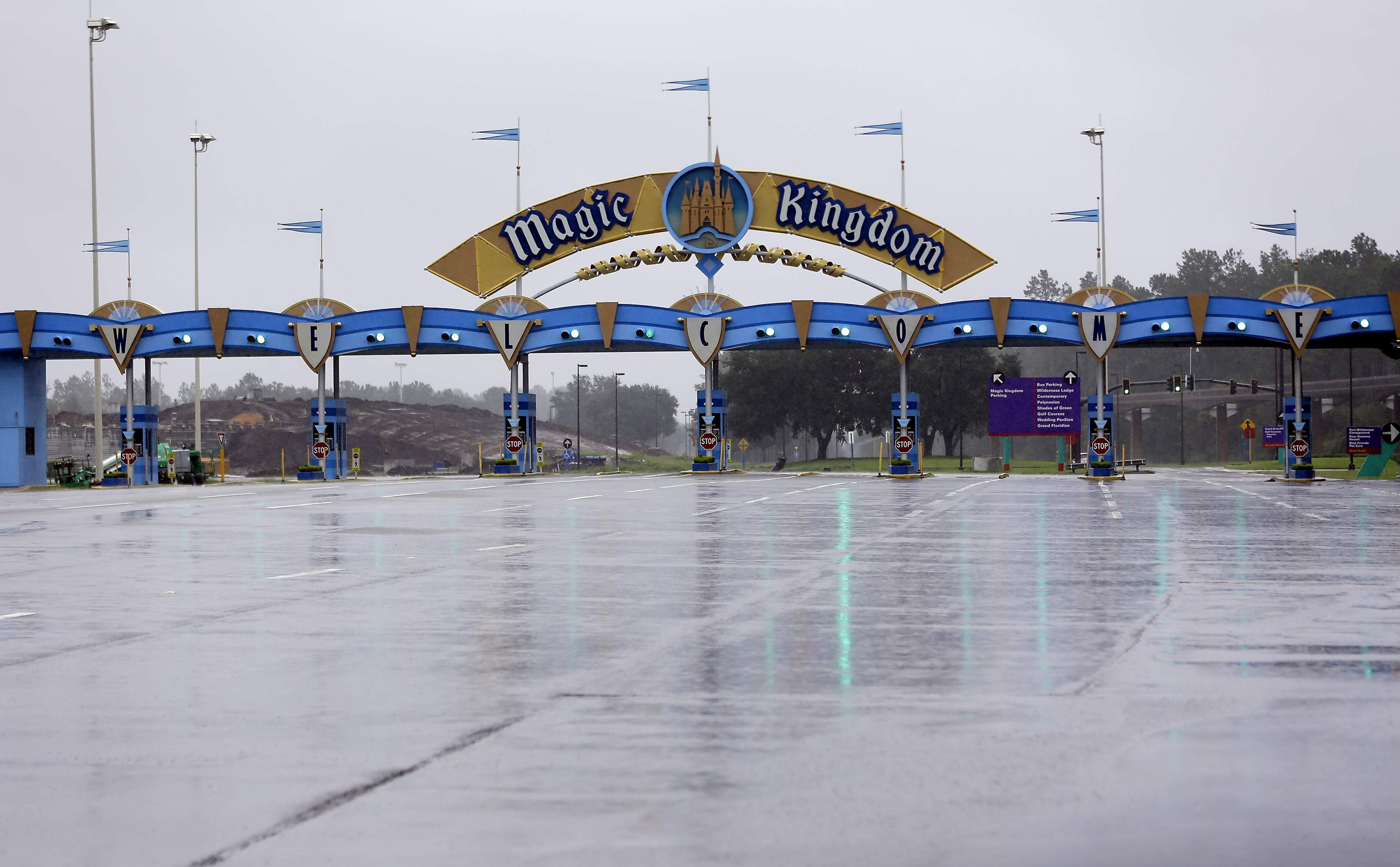 The entrance to the Magic Kingdom at Disney World is empty as the theme park was closed because of Hurricane Irma, Sunday, Sept. 10, 2017, in Lake Buena Vista, Fla. Other tourists attractions including Universal Studios and Sea World were also closed and planned to reopen Tuesday. (AP Photo/John Raoux)