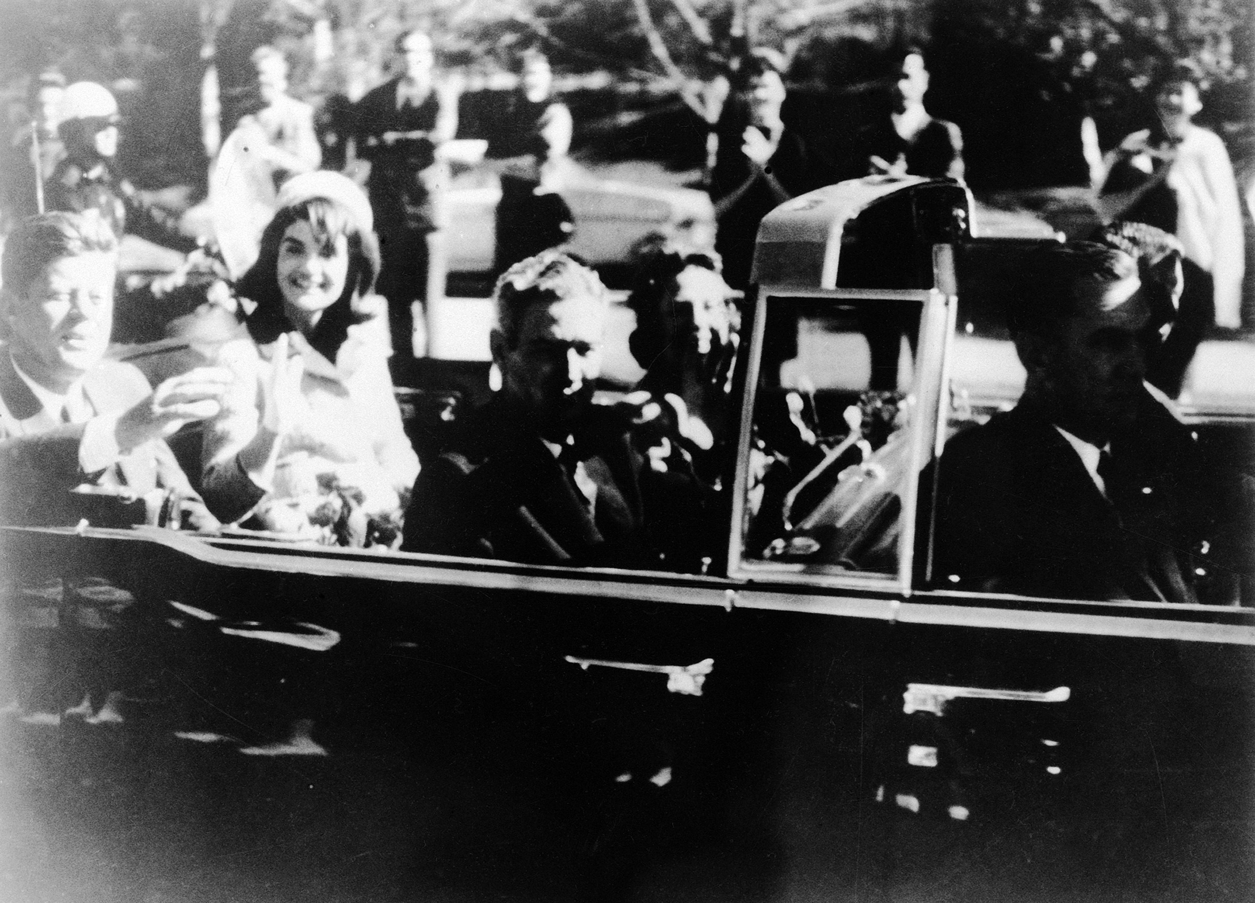 This image provided by the Warren commission, shows Warren Commission Exhibit No. 697, President John F. Kennedy at the extreme right on rear seat of his limousine during Dallas, motorcade on Nov. 22, 1963. (Warren Commission via AP)<p></p>