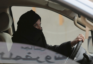 Saudi women take the wheel, test-driving a new freedom