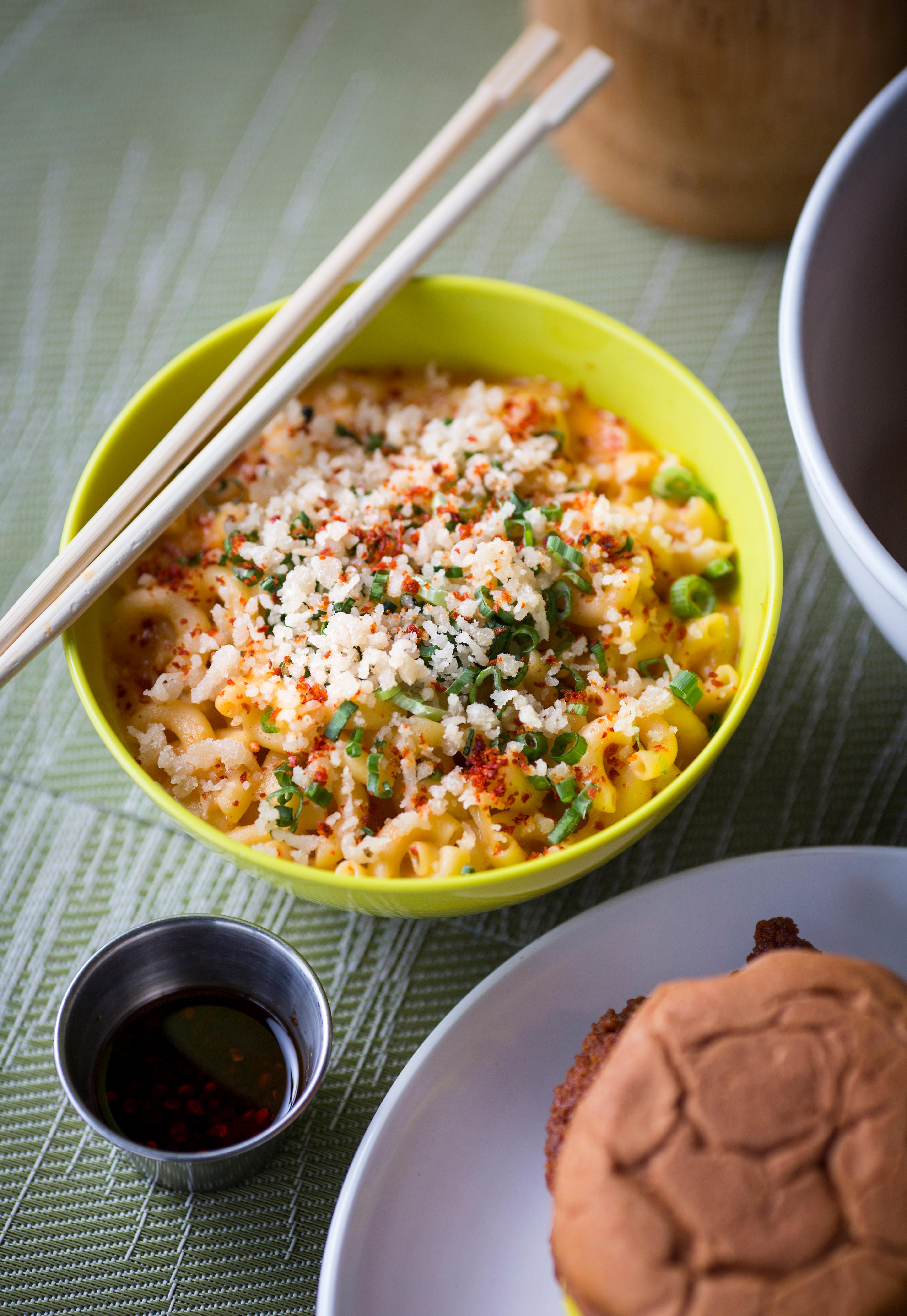 The Mac N' Kimcheese is bowl full of macaroni covered in white cheddar and kim cheese sauce, topped with tempura crispies, green onion as garnish, and chili garlic salt for a kick, at Ma'Ono in West Seattle. The restaurant popped up almost four years ago and is a Hawaiian inspired, asian fusion joint that specializes in Chicken and Whiskey. If the rain has got you down, head on over to Ma'Ono for some soul food. (Sy Bean / Seattle Refined)