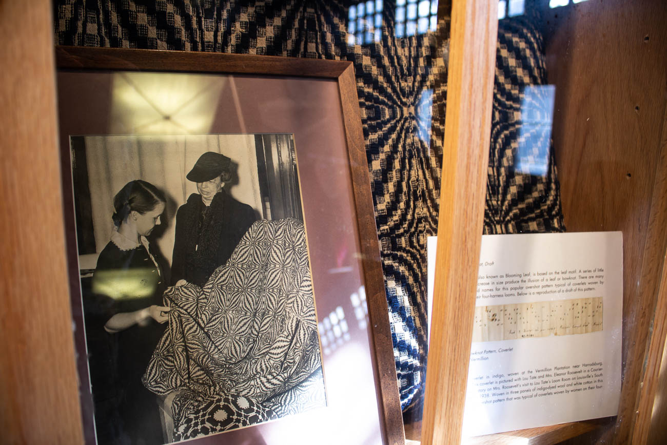 A photo of Lou Tate with Eleanor Roosevelt, a fan of her weaving works and publications, sits in a display in the museum.{ }She commissioned Lou to weave linen placemats with the letter R to be used in the White House. / Image: Katie Robinson, Cincinnati Refined // Published: 12.15.18