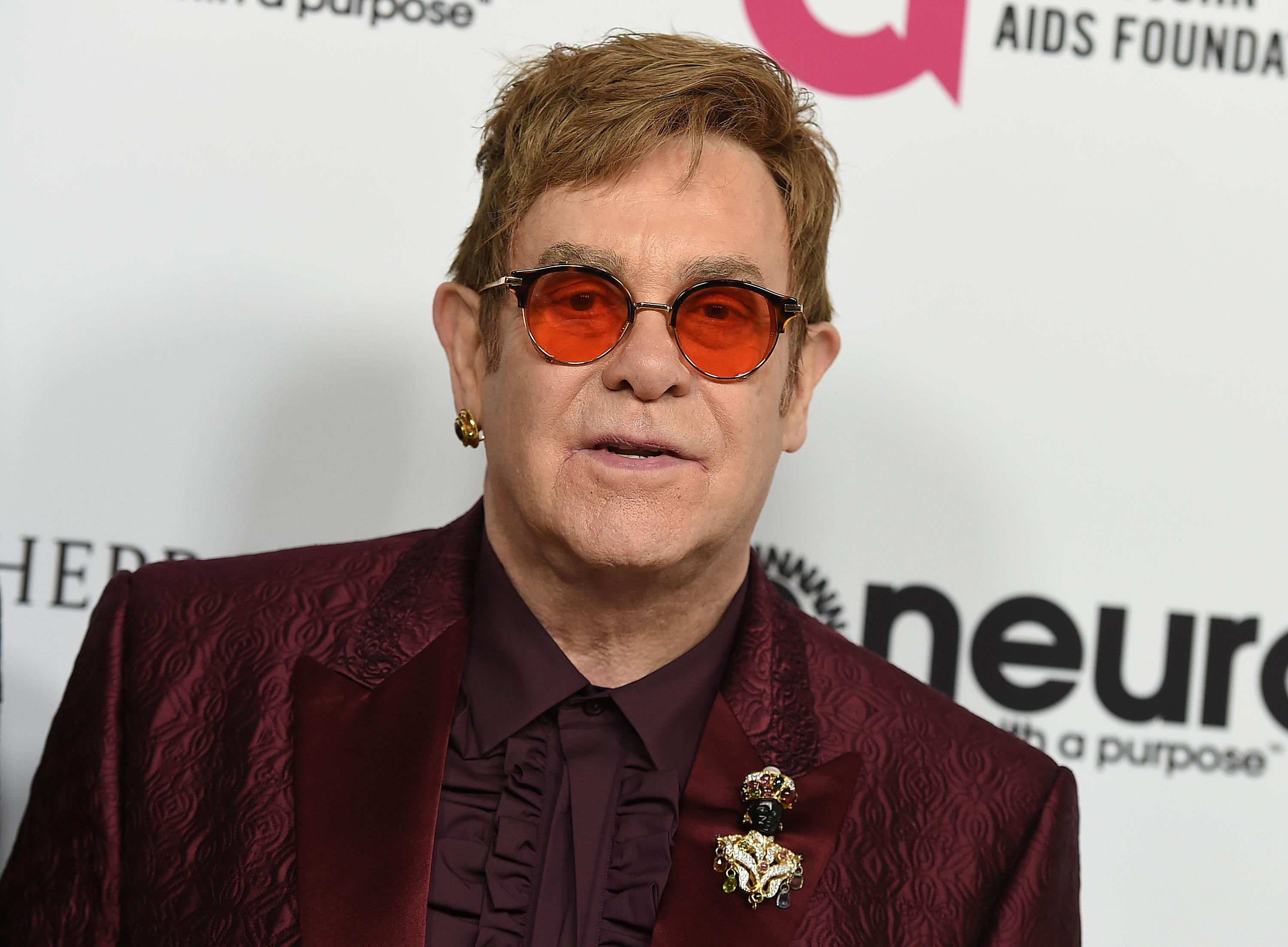 FILE - In this March 25, 2017, file photo, Elton John arrives at Elton John's 70th Birthday and 50-Year Songwriting Partnership with Bernie Taupin celebration in Los Angeles.{ } (Photo by Jordan Strauss/Invision/AP, File)