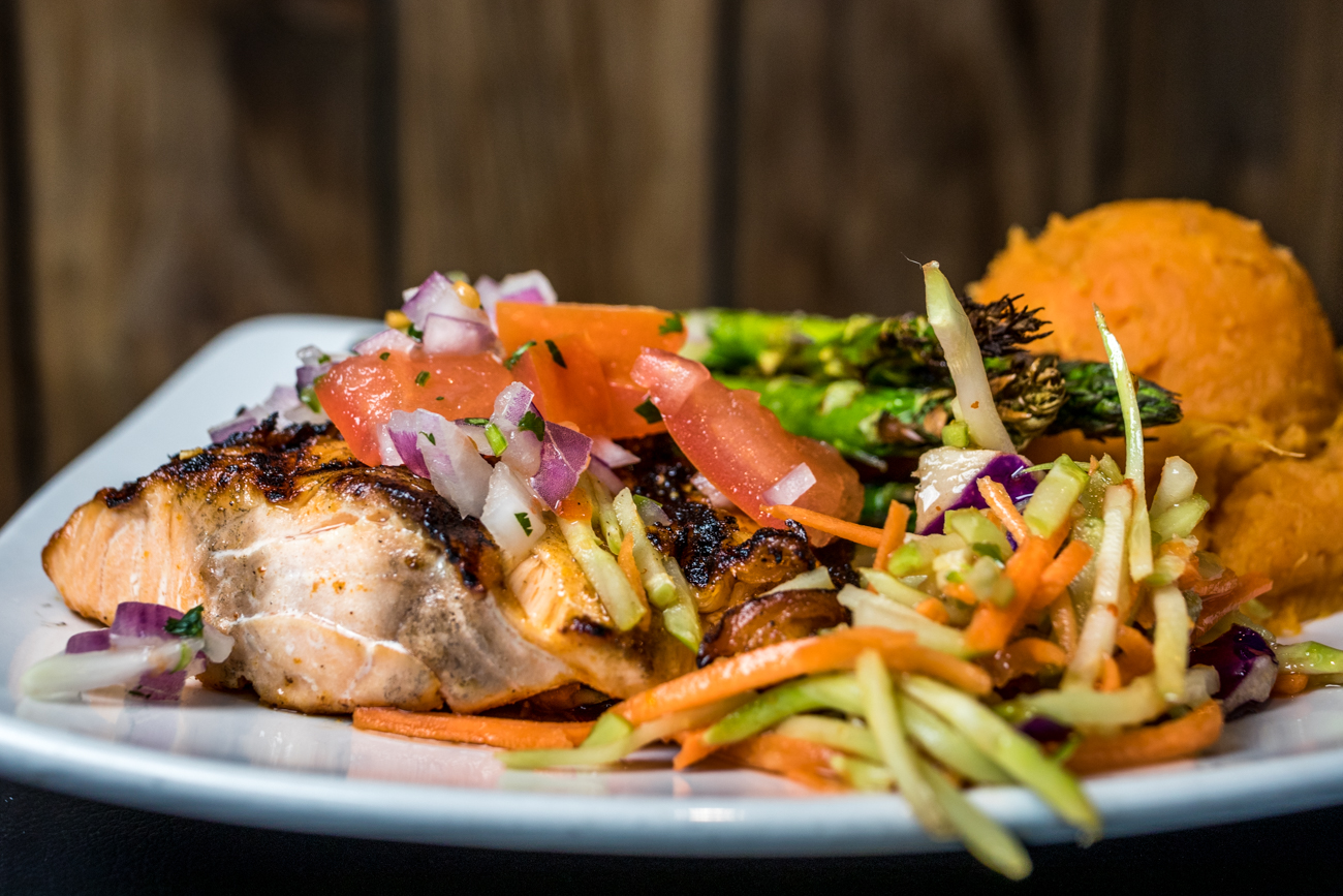 Kingston Salmon: mango habanero-rubbed salmon grilled and topped with pineapple salsa and served with sweet chili slaw, asparagus, and mashed sweet potatoes / Image: Catherine Viox // Published: 3.7.20