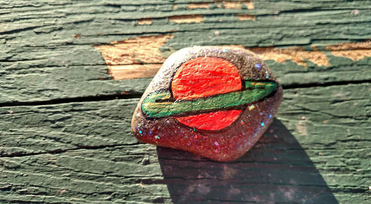 Group member Mona Woodruff's father had Alzheimer's and found a rock during a walk they were taking together, which inspired him to start painting them himself. Other people in the group found out and stepped up to paint rocks to hide along his regular path so he could discover even more. / Image: Mona Woodruff     // Published: 8.17.19