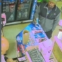 Man walks out of liquor store with cash and soda