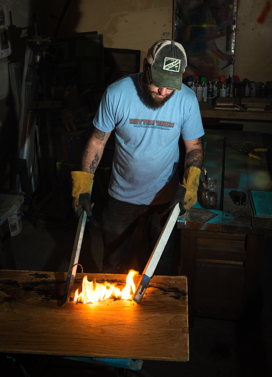 Artist Matt Meyung demonstrating a style of electric wood burning called Lichtenburg that he incorporates into some of his pieces{ }/ Image: Melissa Sliney // Published: 6.26.19