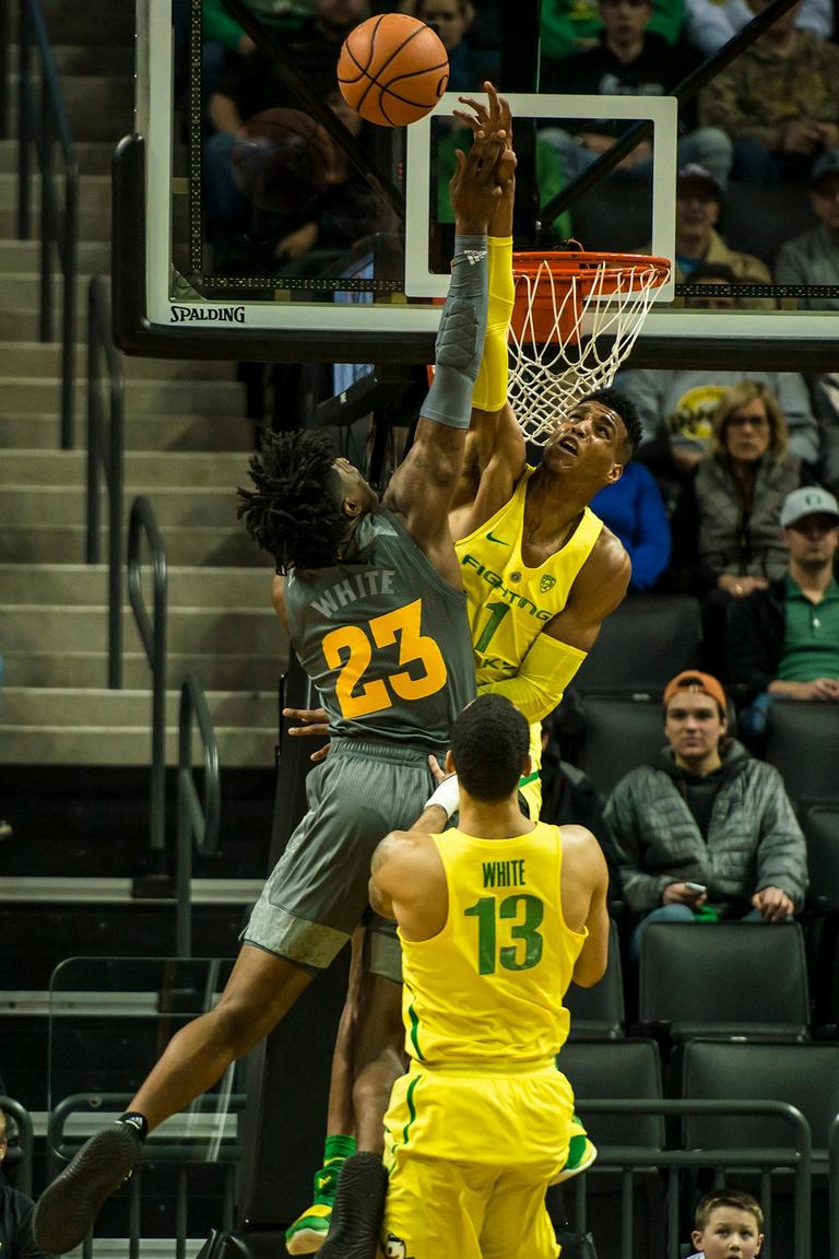 Oregon's Kenny Wooten (1) blocks an ASU player in their matchup at Matthew Knight Arena Thursday. Oregon defeated ASU 75-68 to improve their season record to 18-10 (8-7 PAC-12). The Ducks face off against fourteenth ranked Arizona for their final home game of the season at Matthew Knight Arena on Saturday. (Photo by Colin Houck)