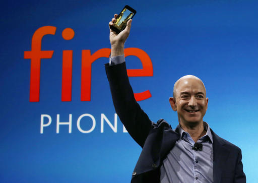 FILE - In this June 18, 2014, file photo, Amazon CEO Jeff Bezos introduces the new Amazon Fire Phone in Seattle. Bloomberg's billionaire index shows Bezos moved past Warren Buffet to become the third richest person in the world on Thursday, July 21, 2016. (AP Photo/Ted S. Warren, File)