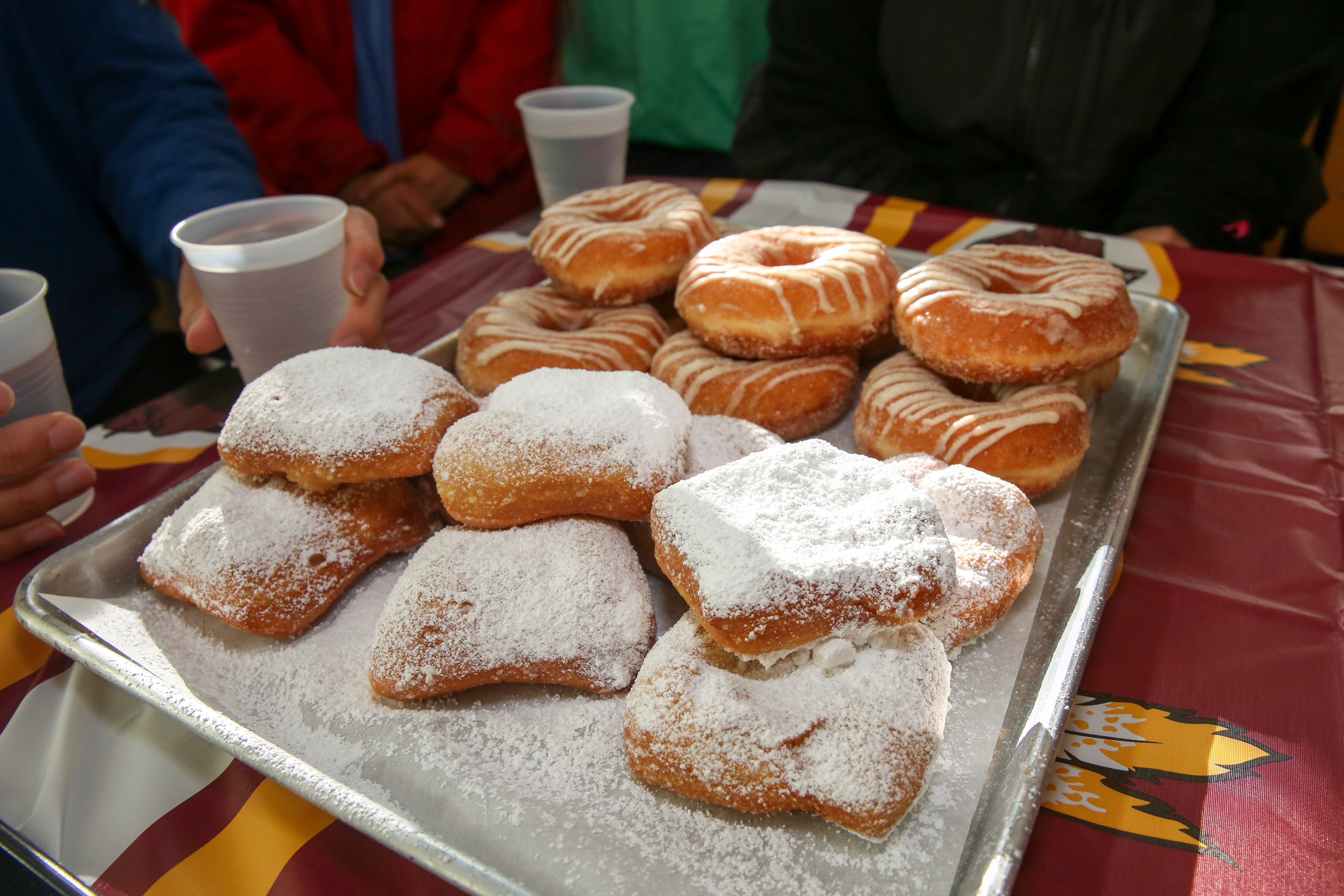 The New Orleans Saints only play the Washington Redskins once every two years and Chef David Guas marked the occasion by hosting a beignet and doughnut eating contest at Bayou Bakery in Arlington. The doughnuts were provided by District Doughnut to represent D.C. and Guas prepared the beignets. The nine challengers had 90 seconds to eat as many items as possible. The winner walked away with $150, but on the field the Saints triumphed by three points. (Amanda Andrade-Rhoades/DC Refined)