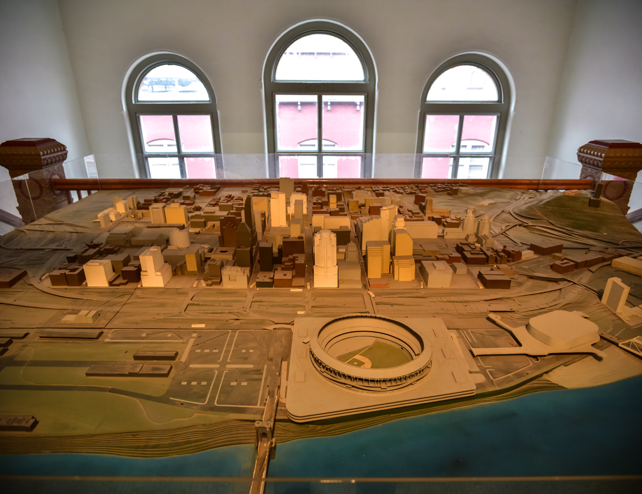 An outdated model of Cincinnati sits upon folding tables on the top floor at the back of City Hall. The now-demolished Riverfront stadium and lack of Great American Tower are among the most obvious differences between today's city and the layout presented in this scale model. / Image: Phil Armstrong, Cincinnati Refined // Published: 1.20.17