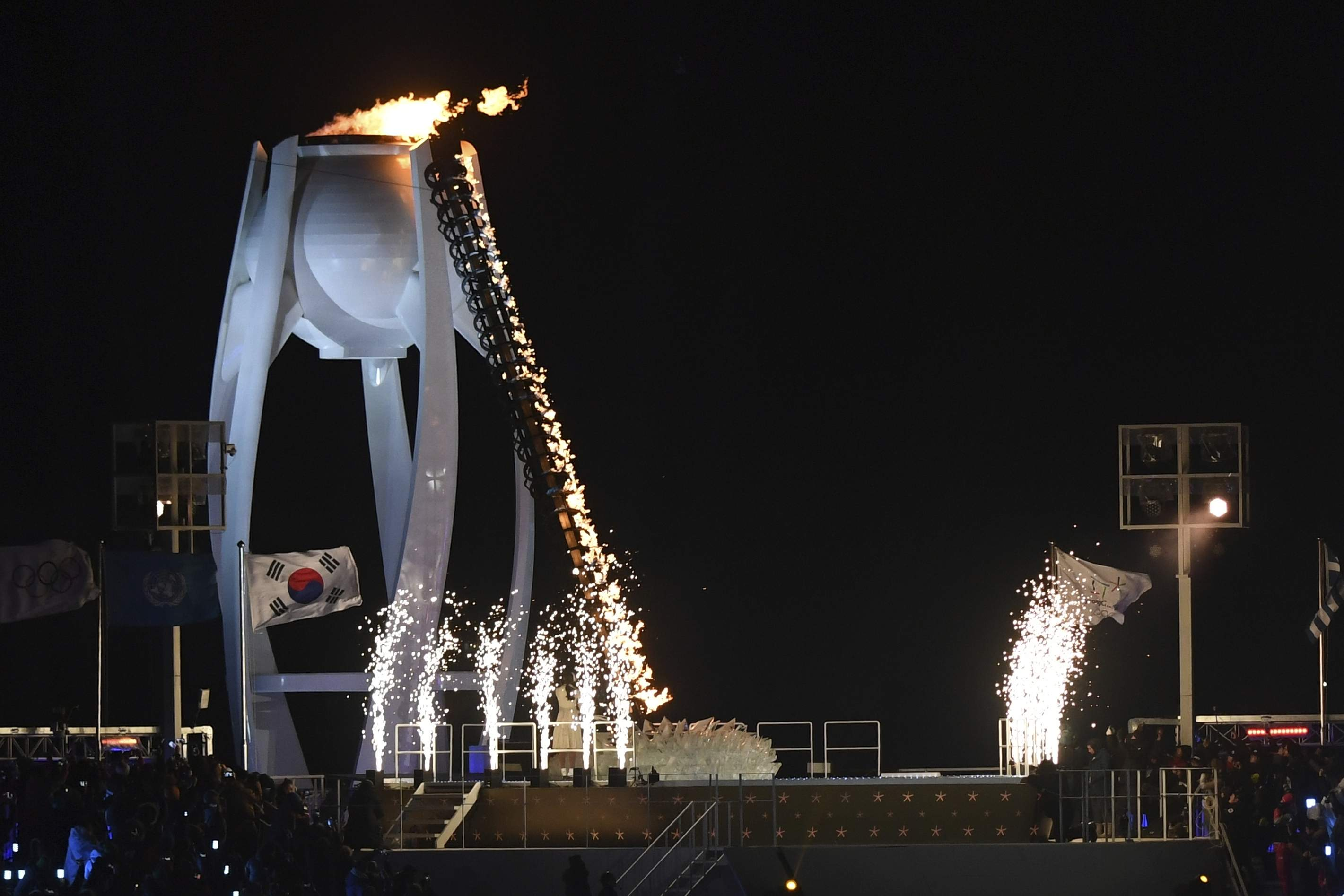 The Olympic flame is lit during the opening ceremony of the 2018 Winter Olympics in Pyeongchang, South Korea, Friday, Feb. 9, 2018. (Christof Stache/Pool Photo via AP)