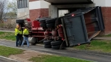 Dump truck flips over after hitting bridge at College at Brockport
