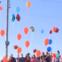 Former classmates of David McFarlin release balloons in his memory