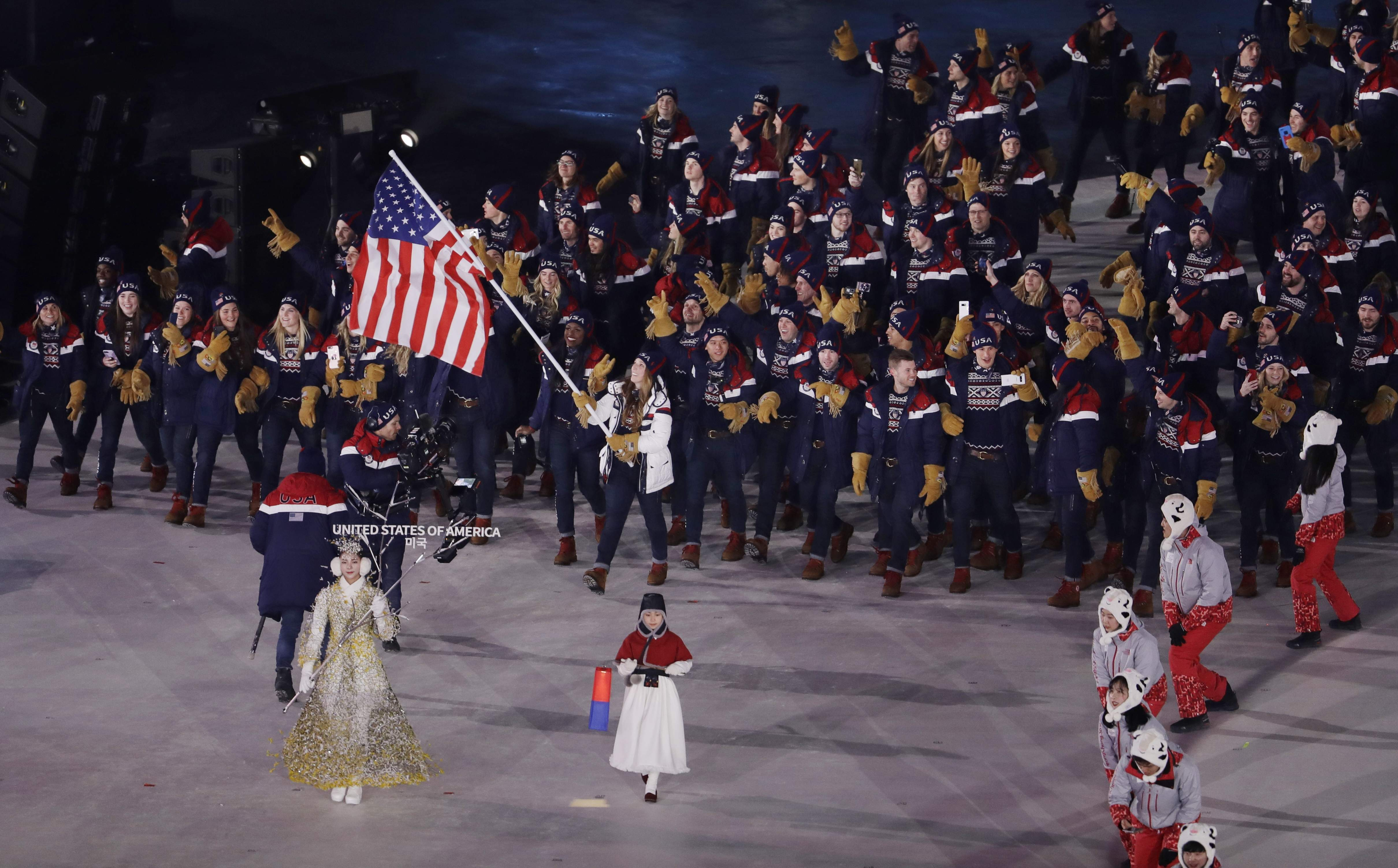 Erin Hamlin carries the flag of the United States during the opening ceremony of the 2018 Winter Olympics in Pyeongchang, South Korea, Friday, Feb. 9, 2018. (AP Photo/Natacha Pisarenko)
