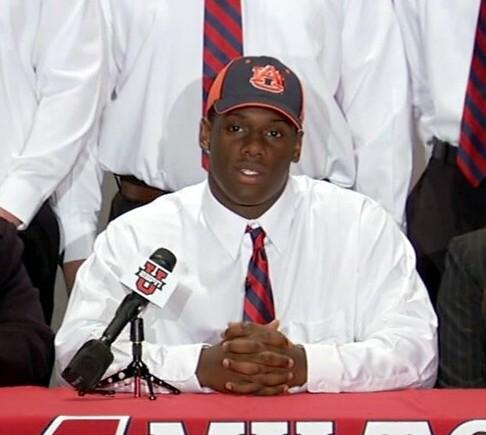 Five-star defensive end Carl Lawson from Alpharetta, Ga. signs his letter of intent to play football at Auburn University on National Signing Day, Wednesday, February 6, 2013.