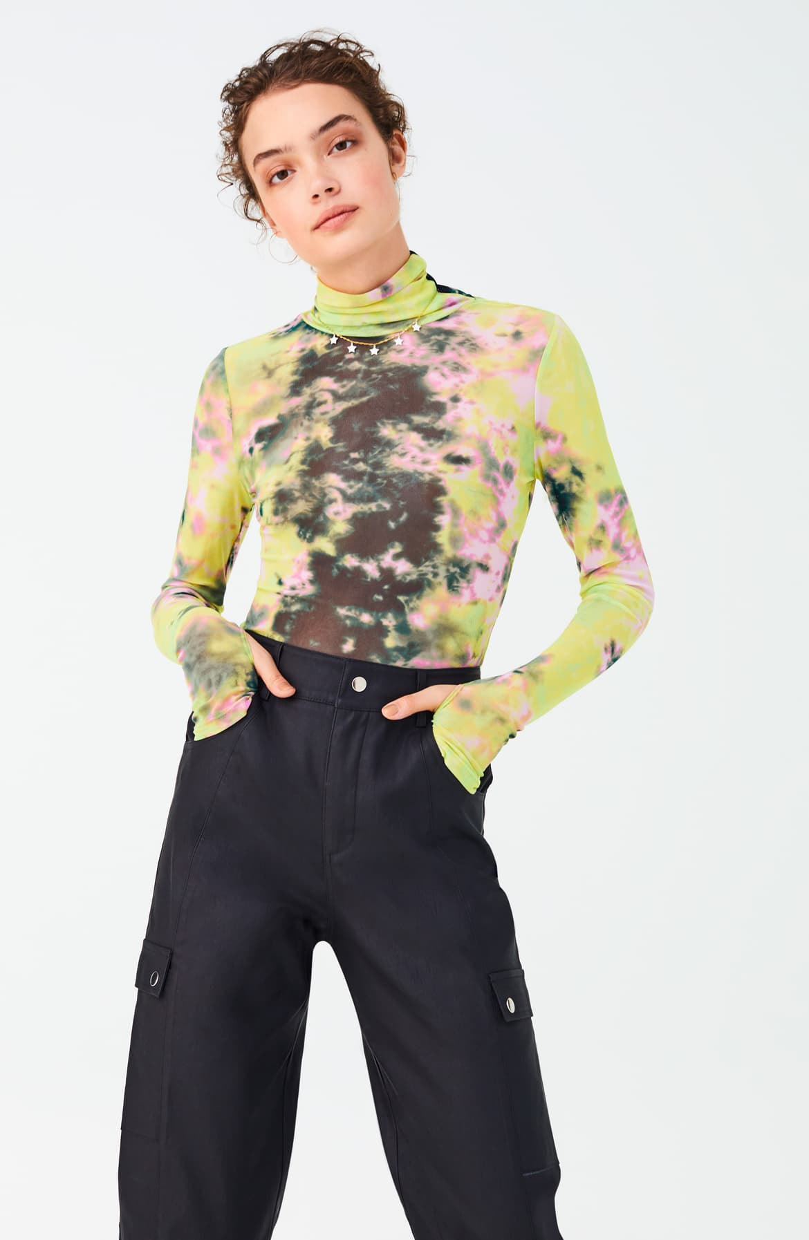 The 1980's were a decade of excess with big shoulders, statement prints and bright neon colors. These trends are making a comeback – in an epic fashion.  We've rounded up some ways you can rock this 'totally tubular' trend, without going full on 'Stranger Things'. (Image: Nordstrom){ }