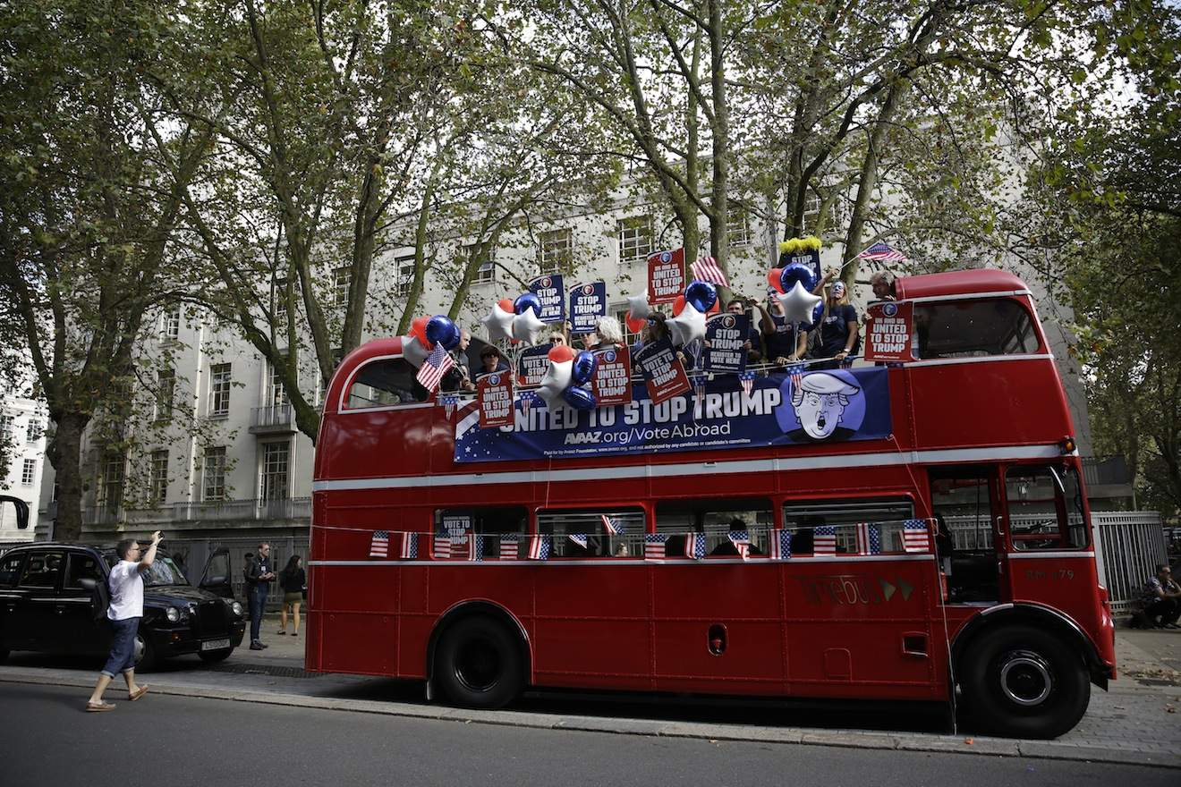 Opponents of Republican presidential candidate Donald Trump prepare to travel round central London aboard an open-top double decker þÄúSTOP TRUMPþÄù bus to encourage expats to register to vote in the upcoming United States presidential election in central London, Wednesday, Sept. 21, 2016. The bus event was organised by the global online campaign movement Avaaz as the deadline to register to vote is approaching in some American states. (AP Photo/Matt Dunham)