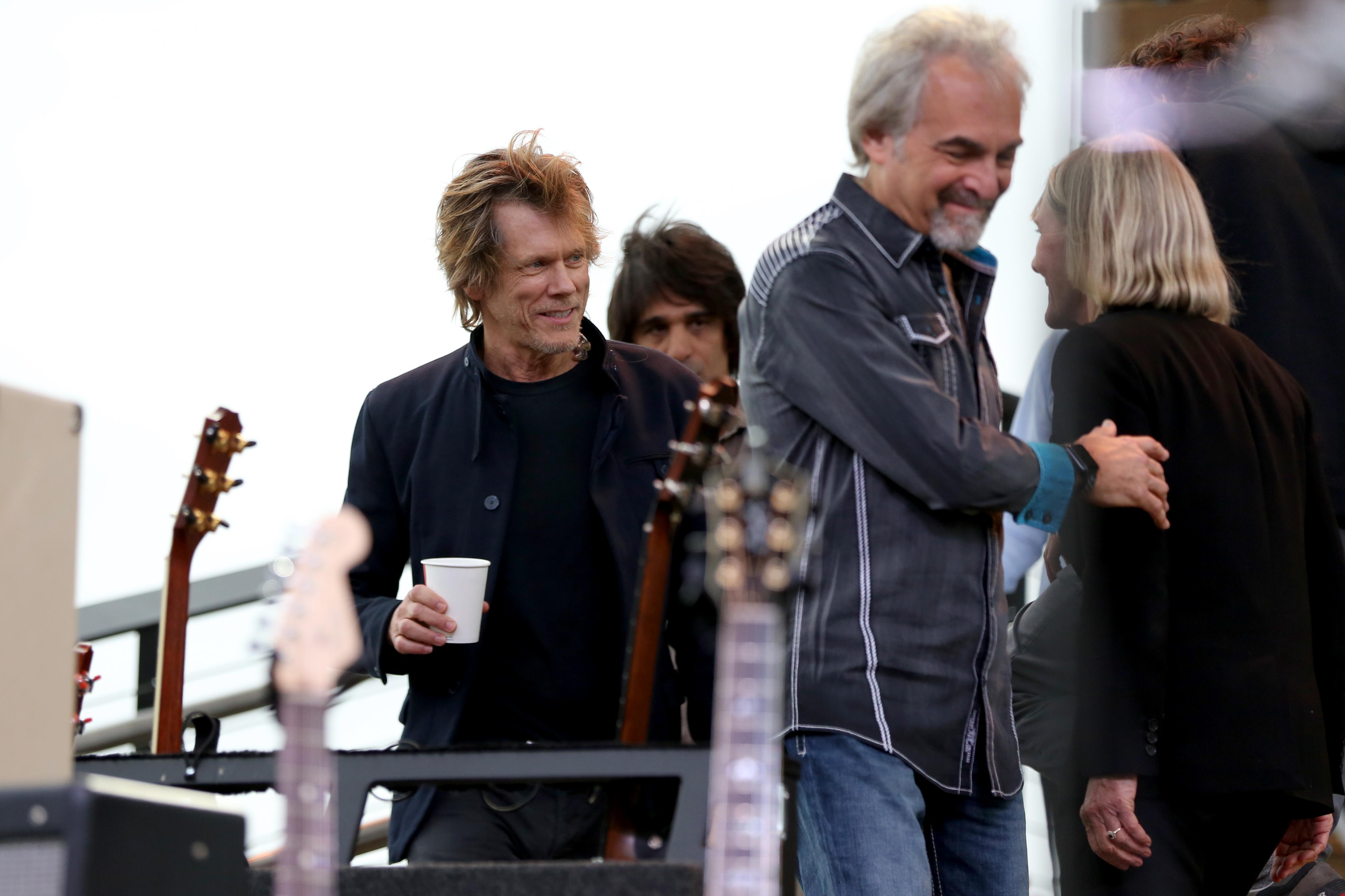 Kevin Bacon and his brother Michael  brought music to the opening of The Wharf. The Bacon Brothers band has been playing since 1995 and their sound leans towards folk rock. (Amanda Andrade-Rhoades/DC Refined)