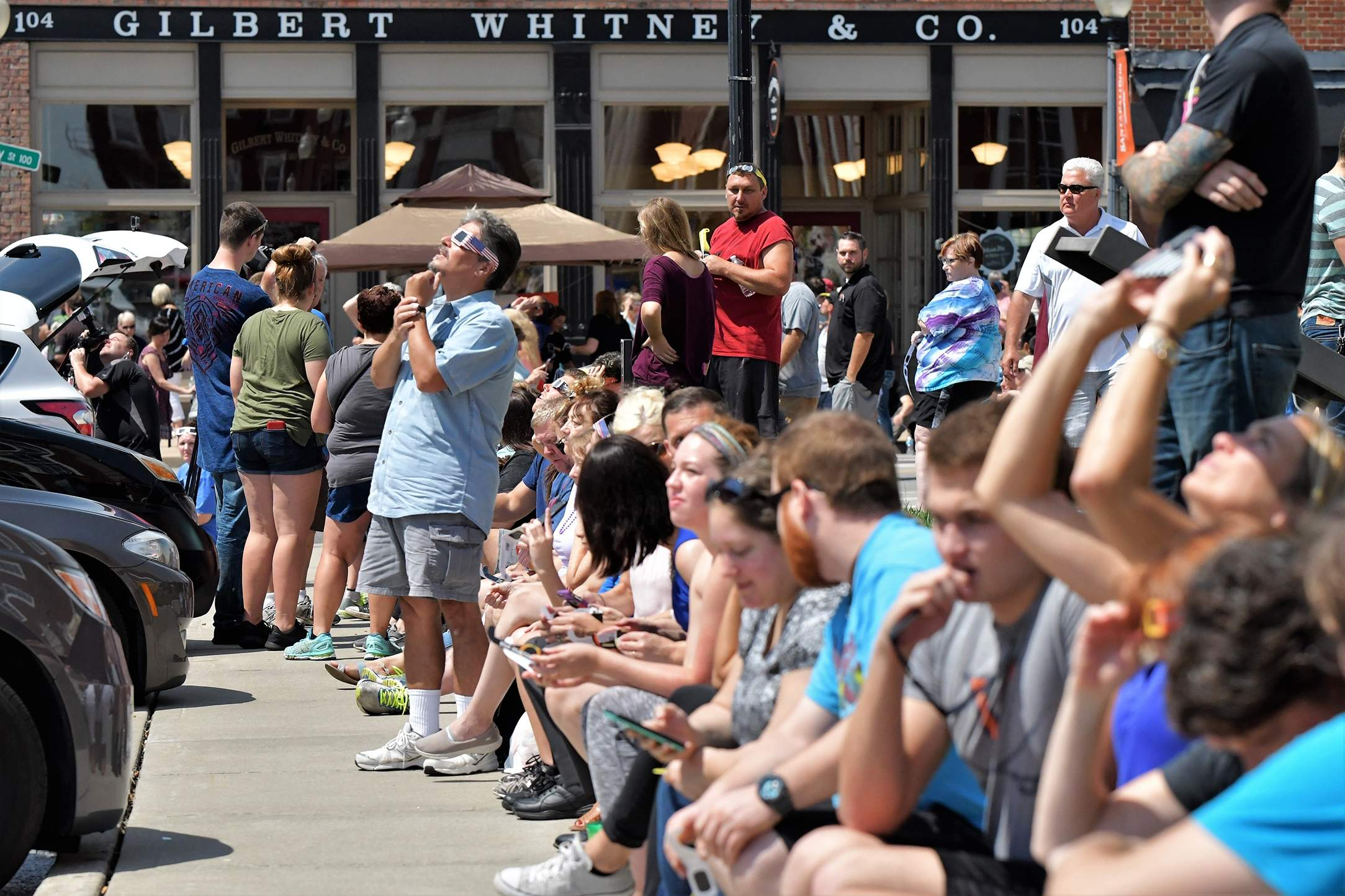 The crowd builds at the Independence Square as the eclipse starts to take form. [David M. Rainey/Special to The Examiner]
