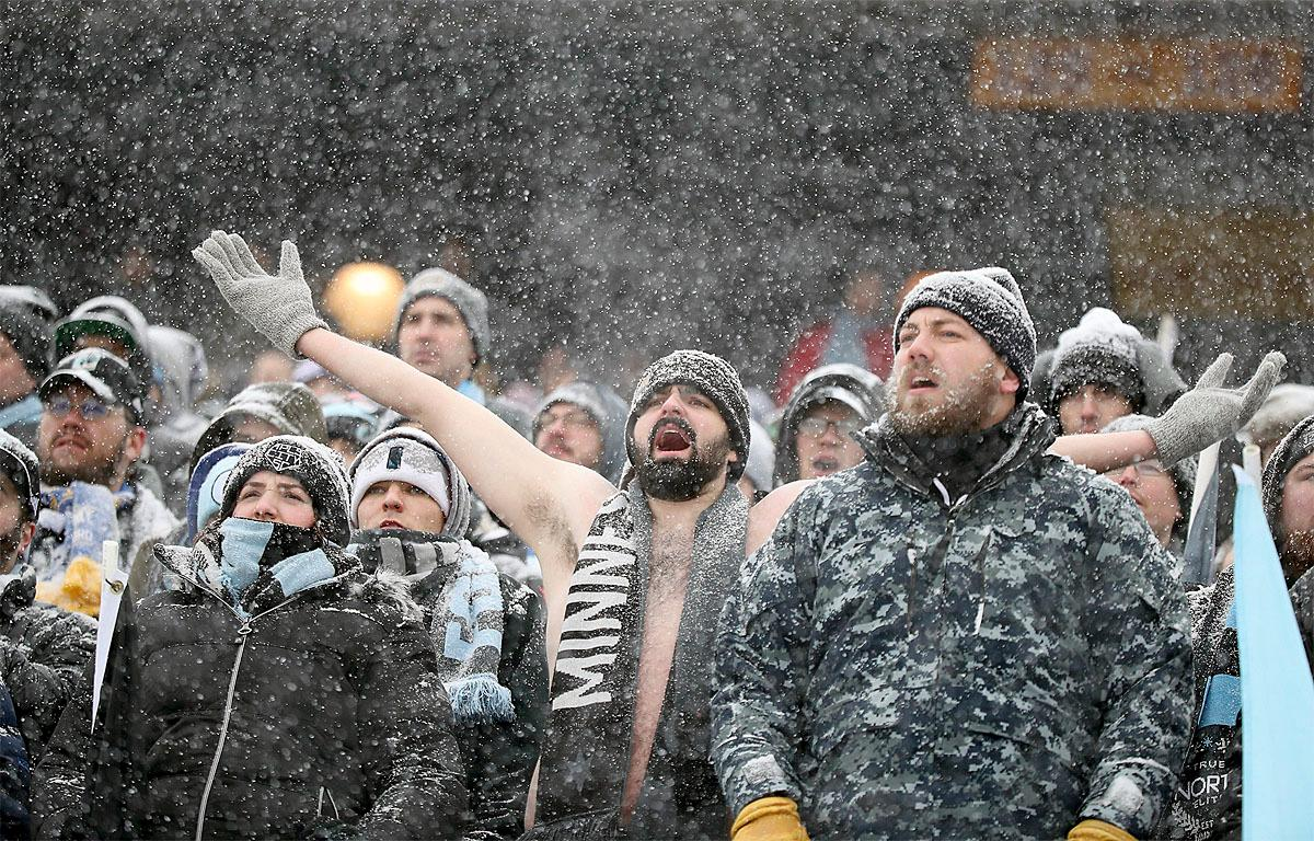 Minnesota United fans brave the cold and snow to cheer for their team during the first half of an MLS soccer game against Atlanta United, Sunday, March 12, 2017, in Minneapolis, Minn. (Elizabeth Flores/Star Tribune via AP)