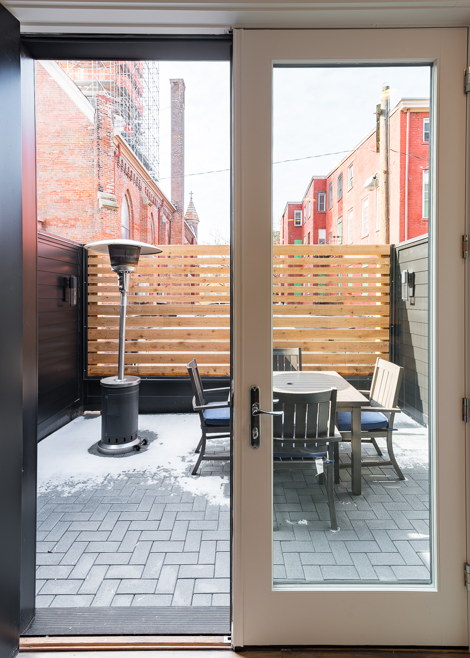 Just off the kitchen is the second floor private patio. / Image: Phil Armstrong, Cincinnati Refined // Published: 2.4.19