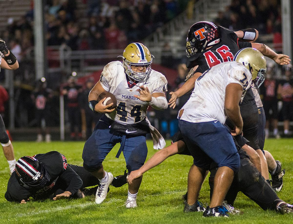 Marist Spartans Aavonte Clark (#44) breaks his way through the Thurston defense for a gain on the carry. Thurston Colts defeated Marist Catholic Spartans 50-14 to seal second place in their conference on Friday night at Thurston High School. Photo by Rhianna Gelhart, Oregon News Lab