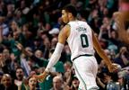 Boston Celtics' Jayson Tatum signals after making a three point basket against the Milwaukee Bucks during the first quarter of an NBA basketball game in Boston, Monday, Dec. 4, 2017.