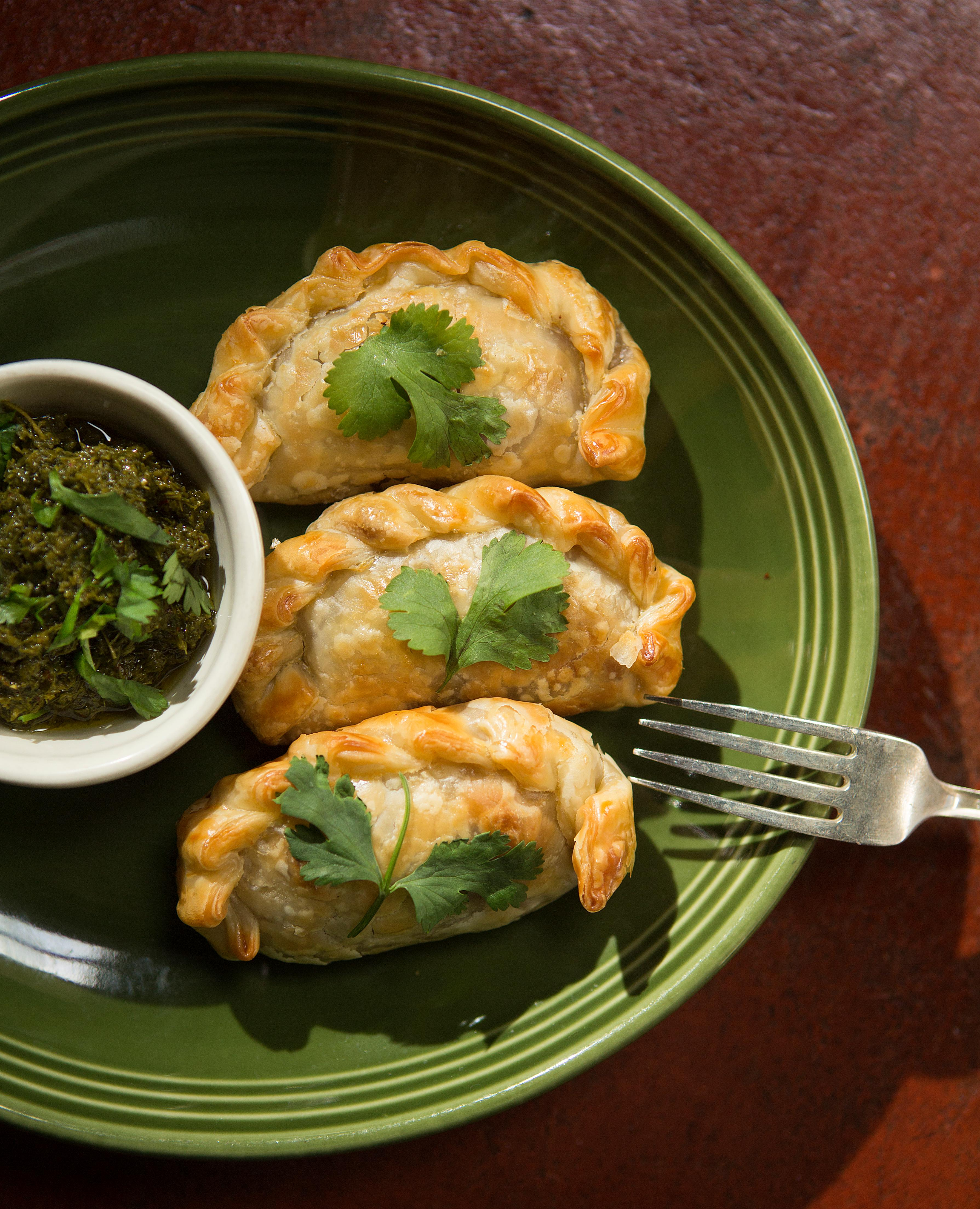 Chef Brian Durbin serves up an Argentinian style empanada, stuffed with savory beef, raisins, and chimichurri sauce on the side. The Innkeeper is a Caribbean-Latin-accented pub for carne asada & rum punch served in a simple space with a back patio. The Innkeeper is located at 2510 1st Ave, Seattle, WA 98121. (Sy Bean / Seattle Refined)